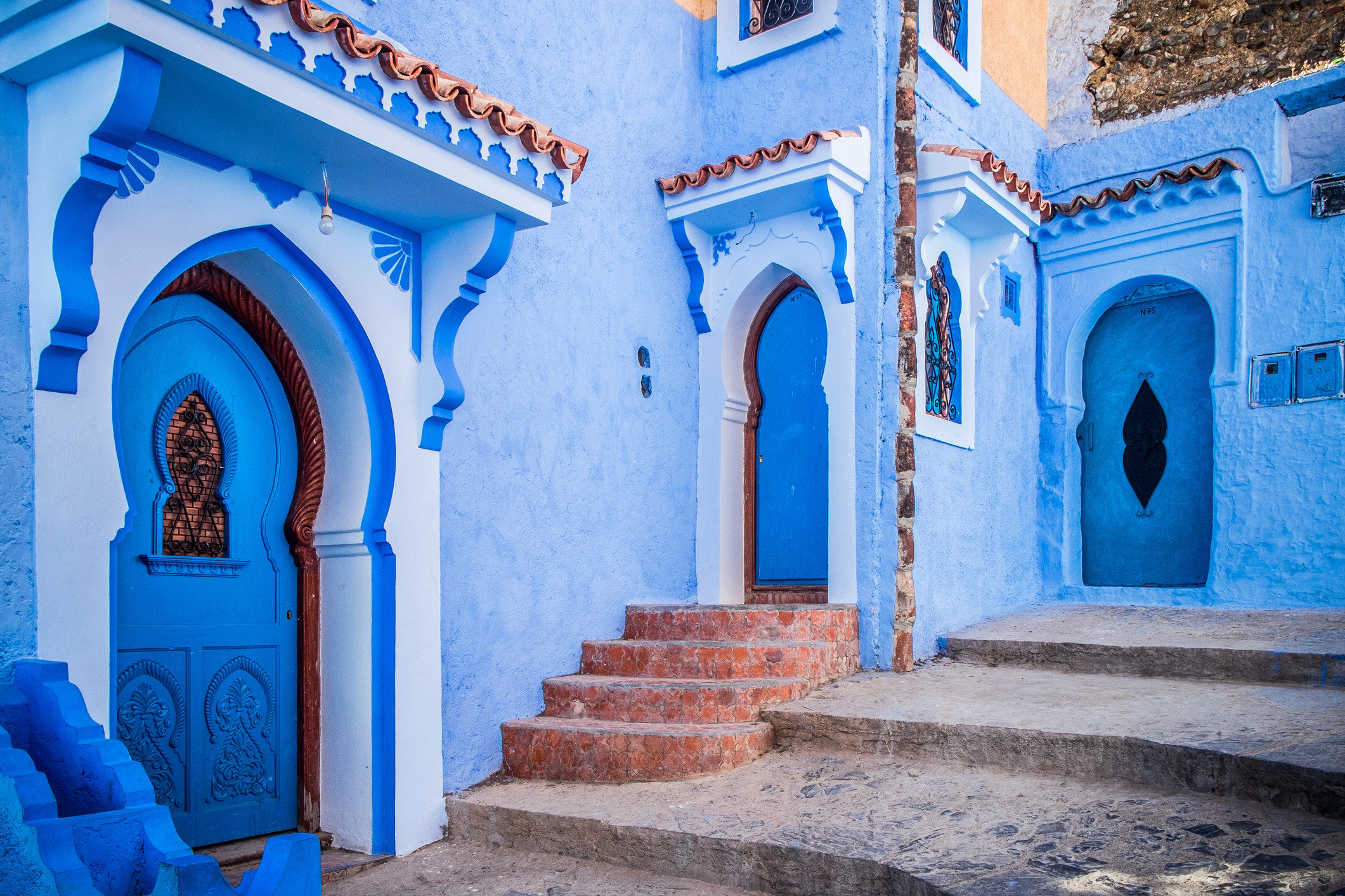 Arts + Culture Marrakech Morocco Offbeat Style + Design Trip Ideas building color blue Architecture house arch place of worship facade temple monastery stone