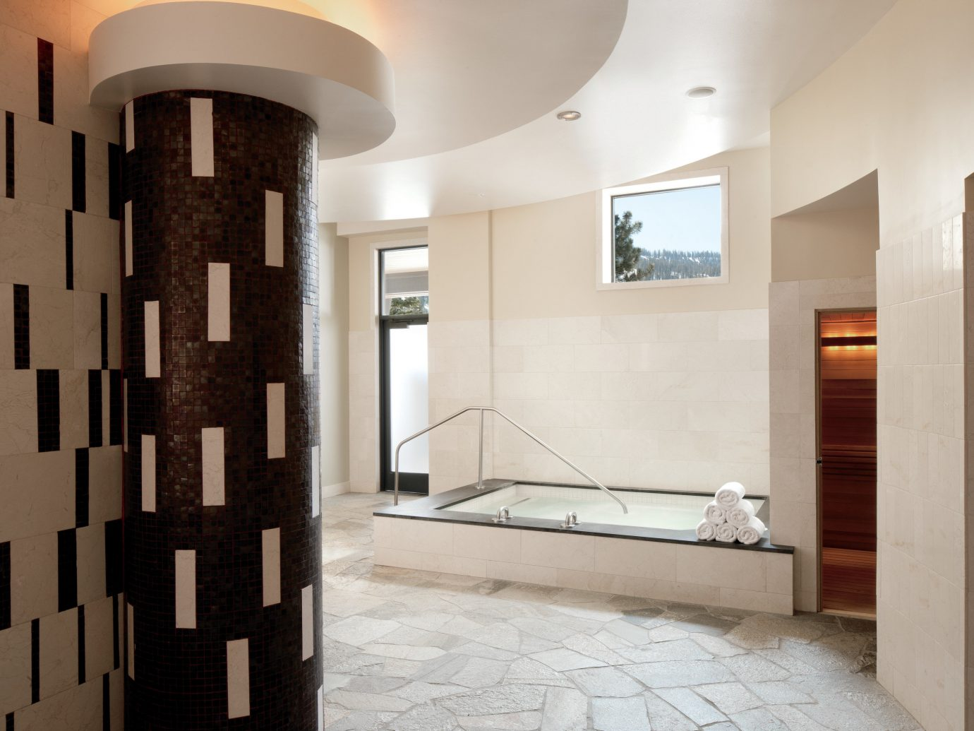 Health + Wellness Spa Retreats Trip Ideas indoor wall ceiling property room building floor Architecture interior design estate home flooring Design living room hall apartment loft tile stone tiled