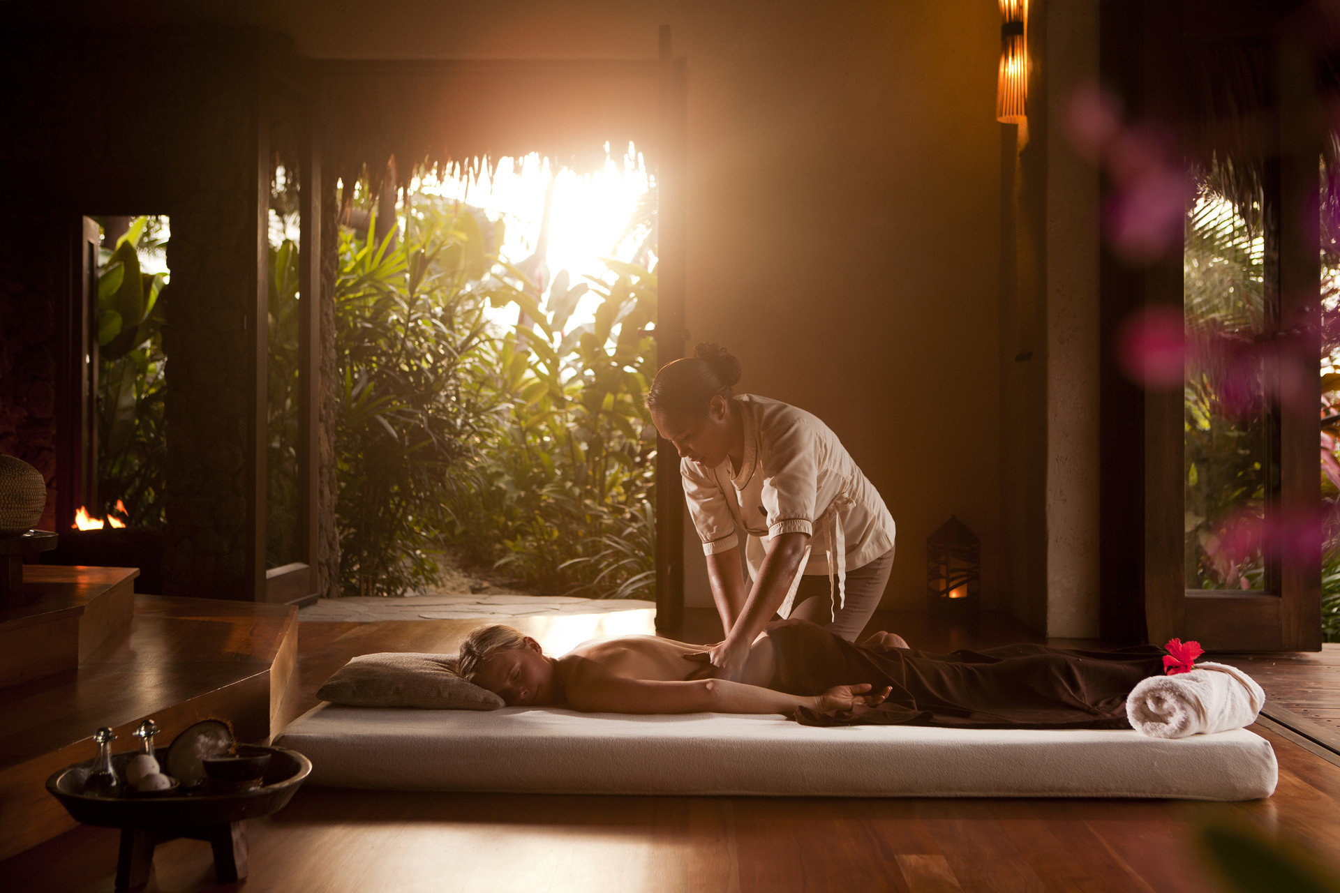 airy calm golden hour Health + Wellness isolation Luxury massage people private quaint relaxation relaxing remote serene Spa Spa Retreats sunlight Sunset Travel Tips Tropical man person interior design lighting living room