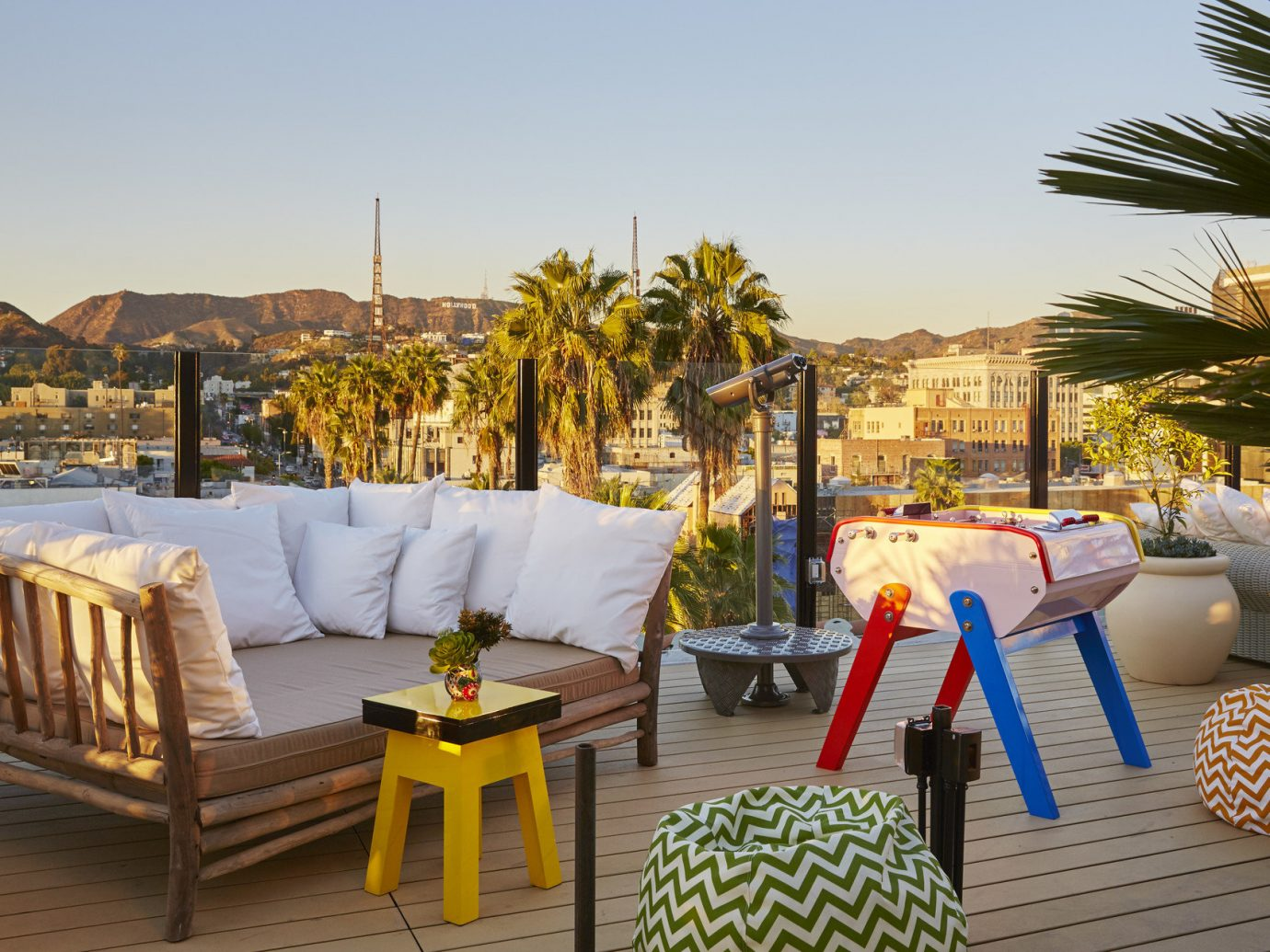Boutique city views Food + Drink glow golden hour Hip Hotels Lounge lounge chairs Offbeat outdoor lounge palm trees Road Trips Rooftop Sunset trendy Trip Ideas Tropical view sky ground outdoor leisure property Resort vacation estate home Villa backyard overlooking