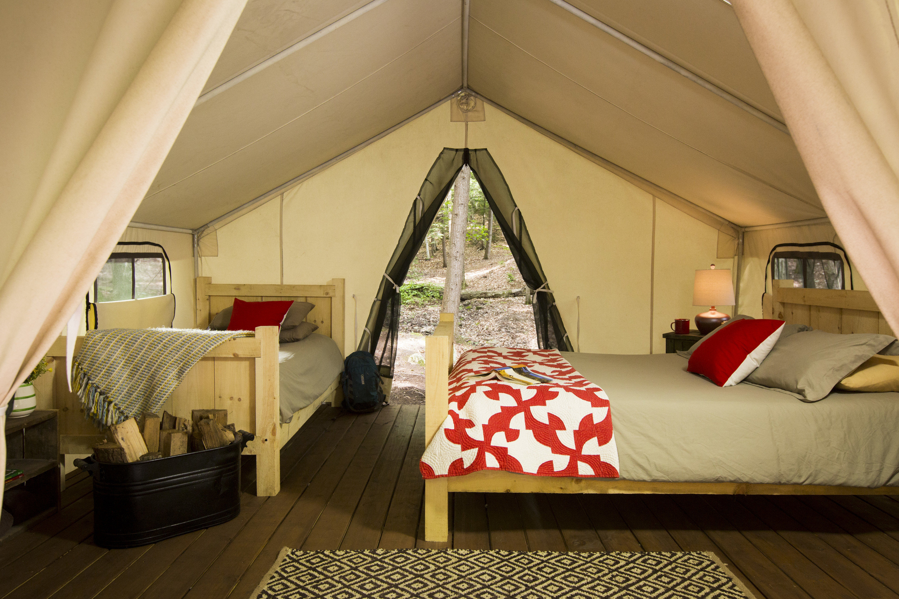 Glamping Outdoors + Adventure Weekend Getaways indoor floor room ceiling Living interior design Bedroom home bed window house Suite estate furniture daylighting attic area