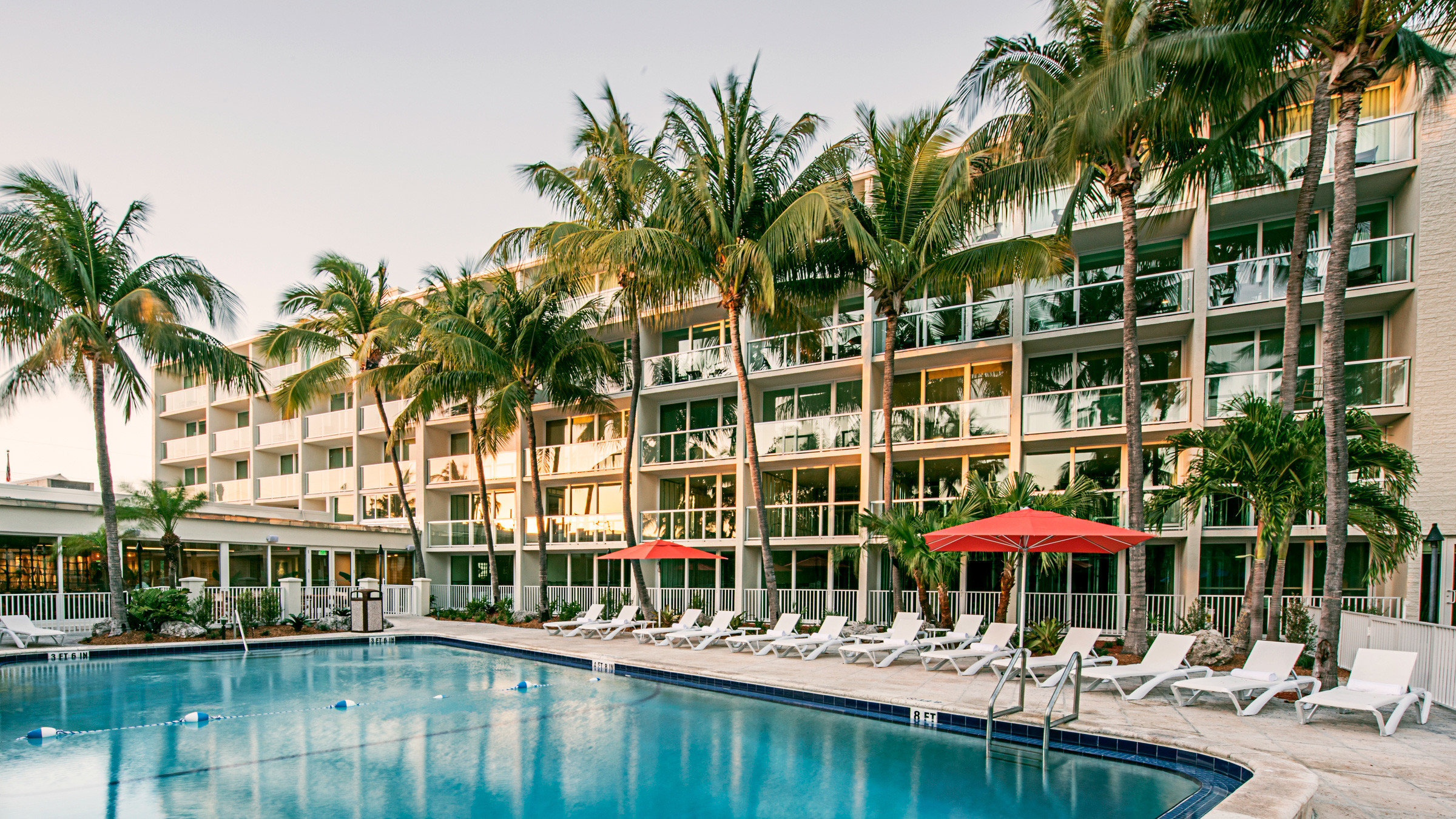 Beach Beachfront Hotels Pool Resort Romance outdoor tree water condominium property leisure chair swimming pool vacation marina estate arecales resort town dock caribbean apartment palm lined swimming surrounded