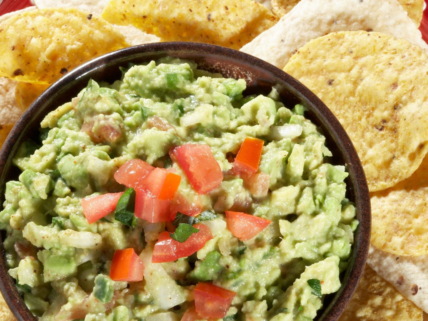 Food + Drink Trip Ideas food dish chip cuisine tostada guacamole vegetable dip rice snack food produce meal vegetarian food breakfast condiment different containing several variety