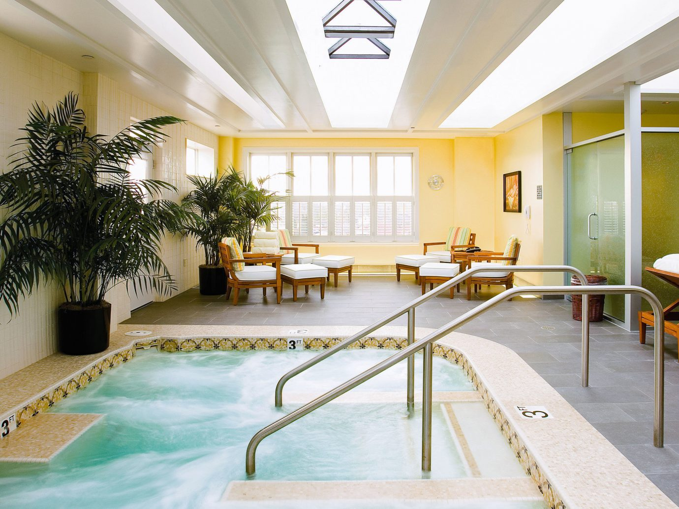 indoor swimming pool building leisure estate interior design real estate leisure centre condominium yellow ceiling home Resort hotel daylighting floor apartment amenity decorated furniture