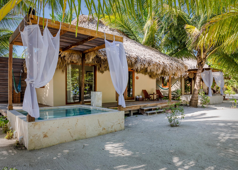 Beachfront Hotels Living Pool Resort Trip Ideas outdoor tree vacation estate hacienda Villa Village restaurant stone curb