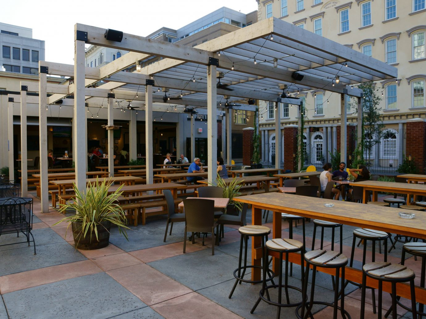 Boutique Hotels Food + Drink Girls Getaways Weekend Getaways building chair outdoor mixed use Patio outdoor structure canopy roof pergola café table Courtyard
