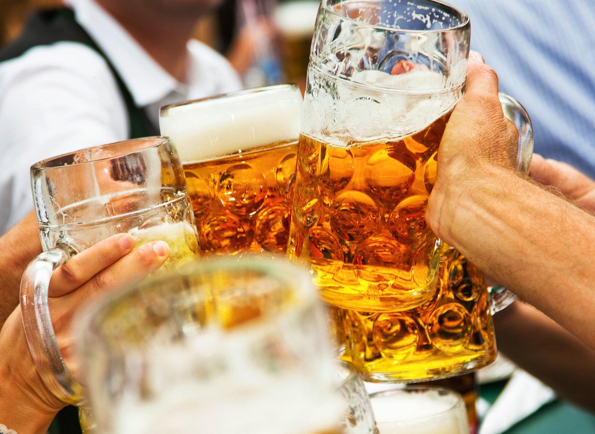 Arts + Culture Fall Travel Festivals + Events Offbeat oktoberfest Trip Ideas person table Drink alcohol sense distilled beverage