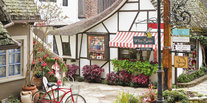 Trip Ideas outdoor building bicycle ground Town neighbourhood home residential area Courtyard sidewalk estate cottage Balcony flower yard restaurant Village stone curb