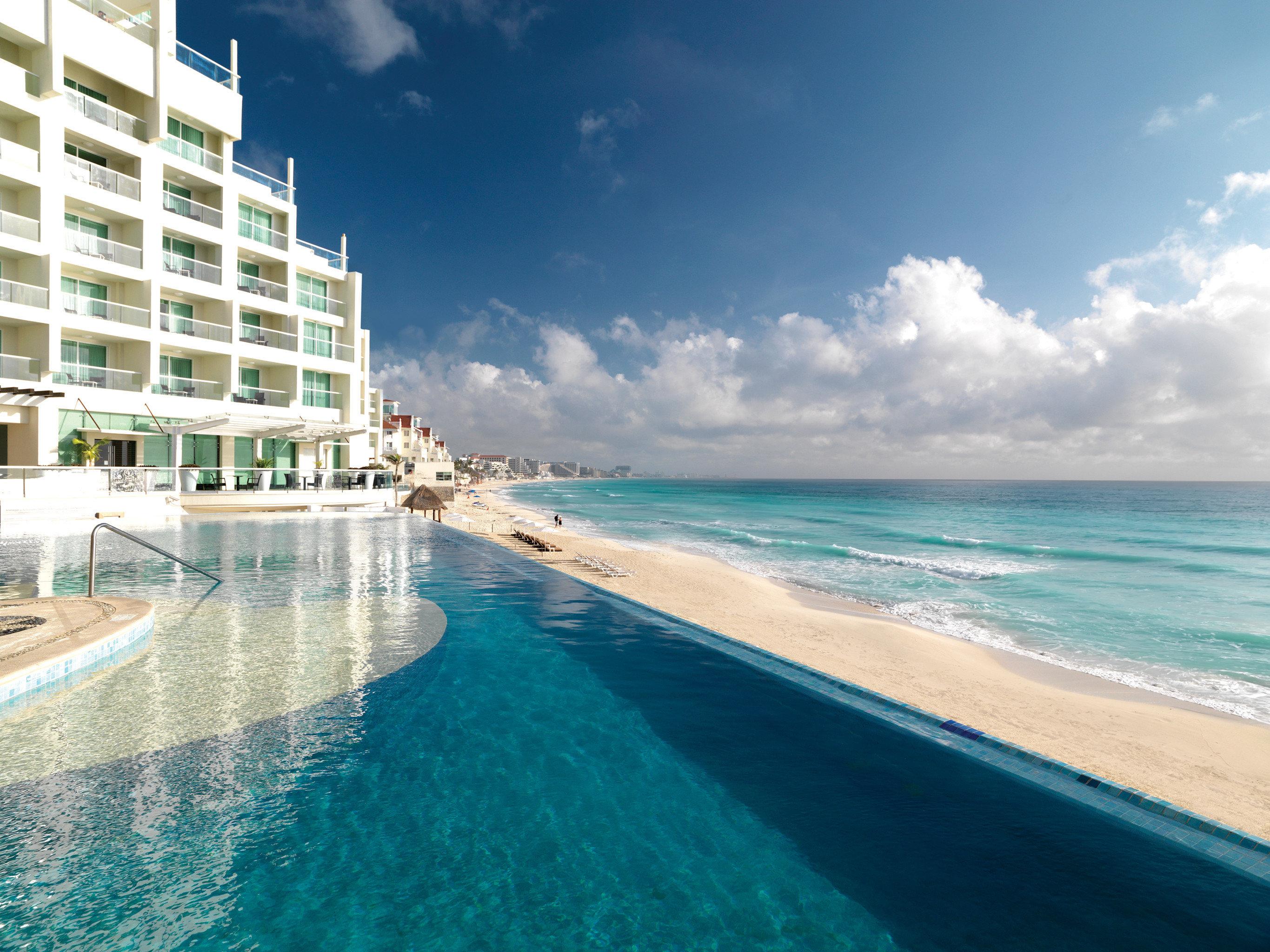 Hotels sky water outdoor Sea Ocean caribbean vacation Beach horizon shore Coast Nature swimming pool bay Resort cape wind wave Lagoon day