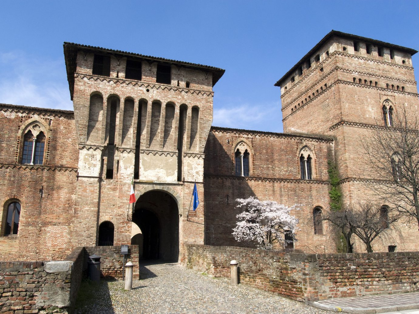 Arts + Culture Italy Milan Trip Ideas historic site medieval architecture building wall history fortification arch sky ancient history castle facade middle ages palace château