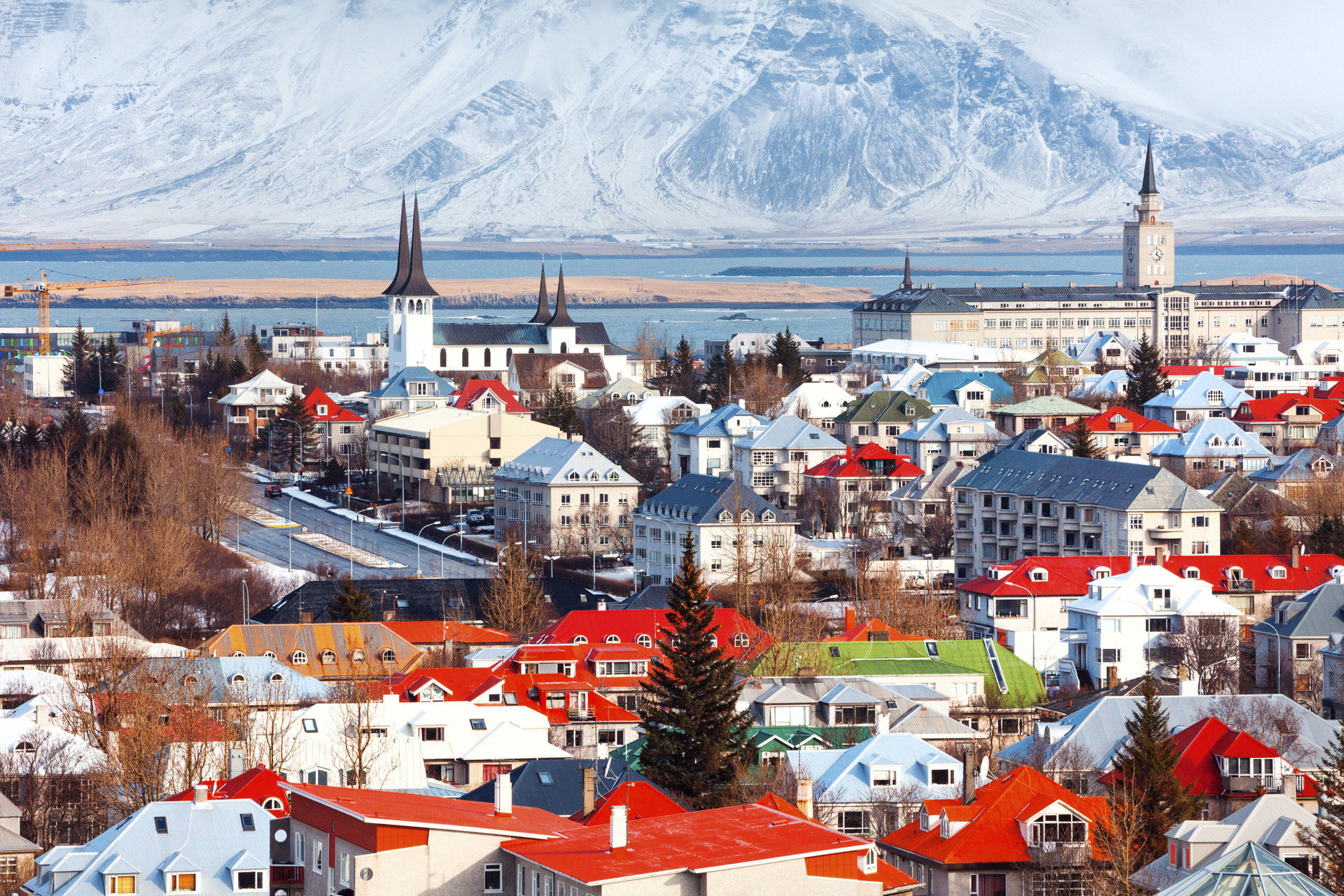 Boutique Hotels Health + Wellness Hotels Iceland Meditation Retreats Offbeat Outdoors + Adventure Reykjavík Road Trips Romance Travel Tips Trip Ideas Yoga Retreats outdoor snow Town City mountain human settlement Winter cityscape Harbor aerial photography panorama