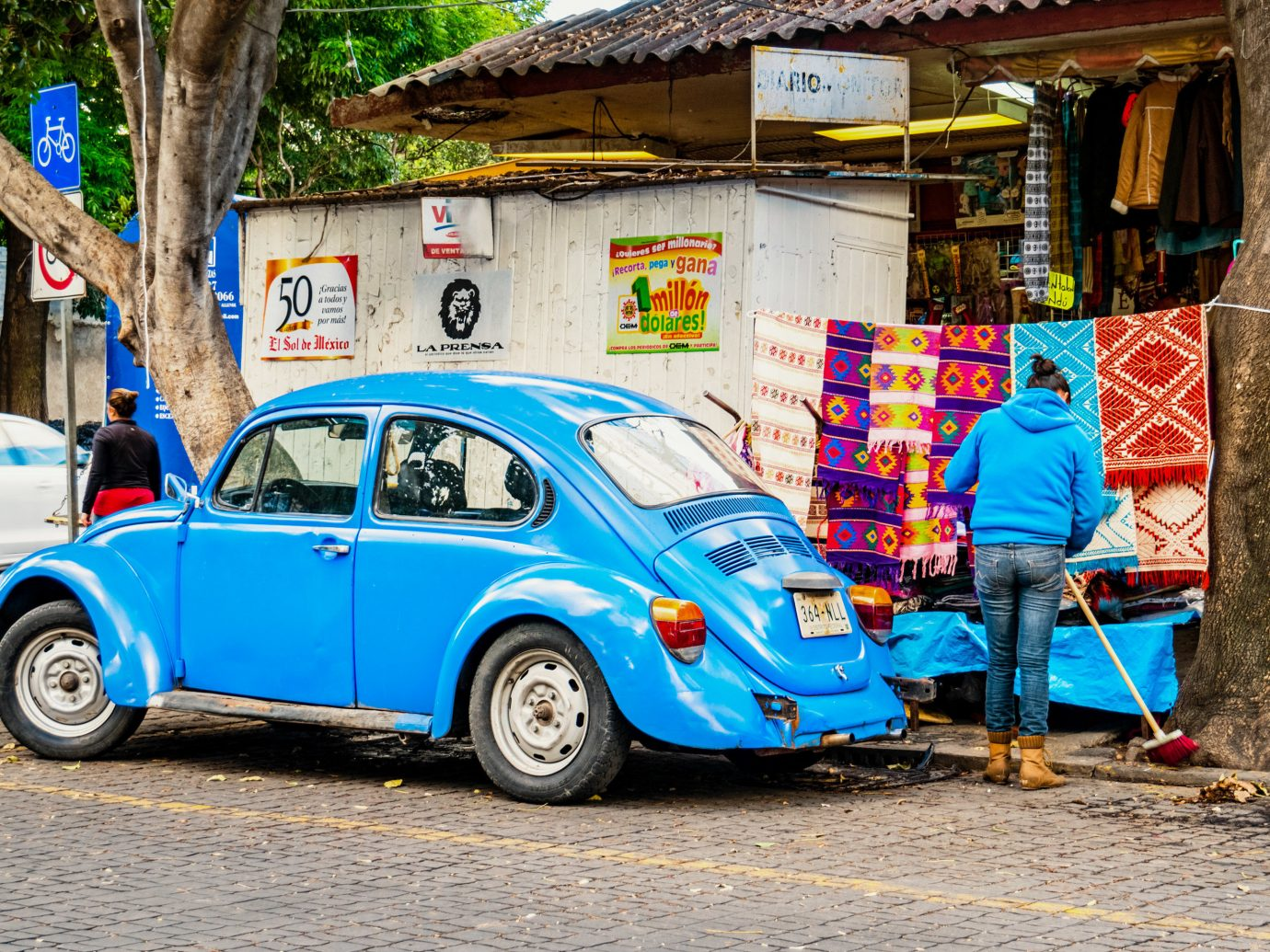 City Mexico City Trip Ideas outdoor building car motor vehicle vehicle volkswagen beetle automotive design Classic blue vintage car subcompact car street antique car parked compact car volkswagen automotive exterior