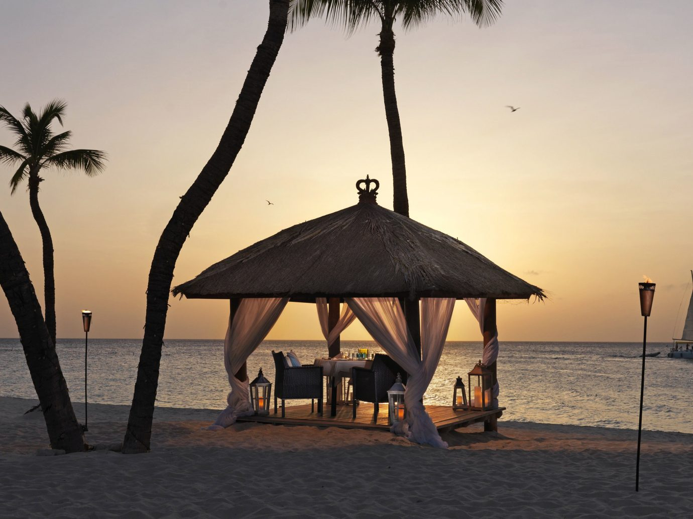 Beach Beachfront Hotels Living Lounge Luxury Ocean sky water outdoor chair Sea shore Sunset vacation morning evening tree Nature palm dusk sand travel sailing vessel shade sandy day