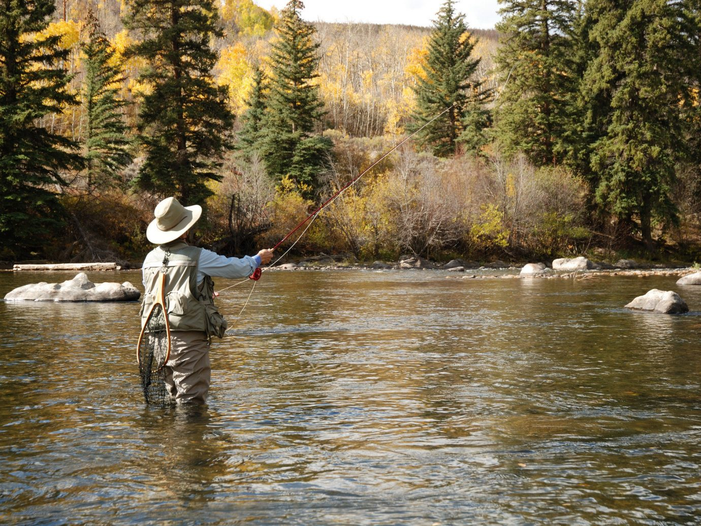 Mountains + Skiing Outdoors + Adventure tree outdoor water River recreational fishing stream Sport watercourse creek fly fishing bank water resources recreation Lake plant fishing landscape