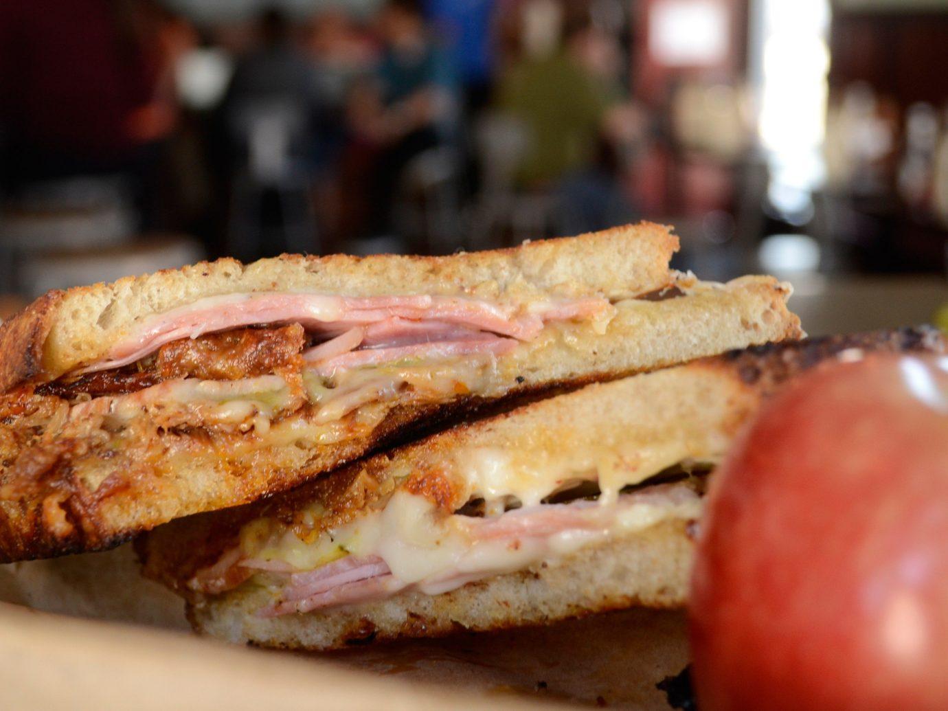 Food + Drink food sandwich indoor dish snack food meal meat lunch delicatessen breakfast cuisine close half