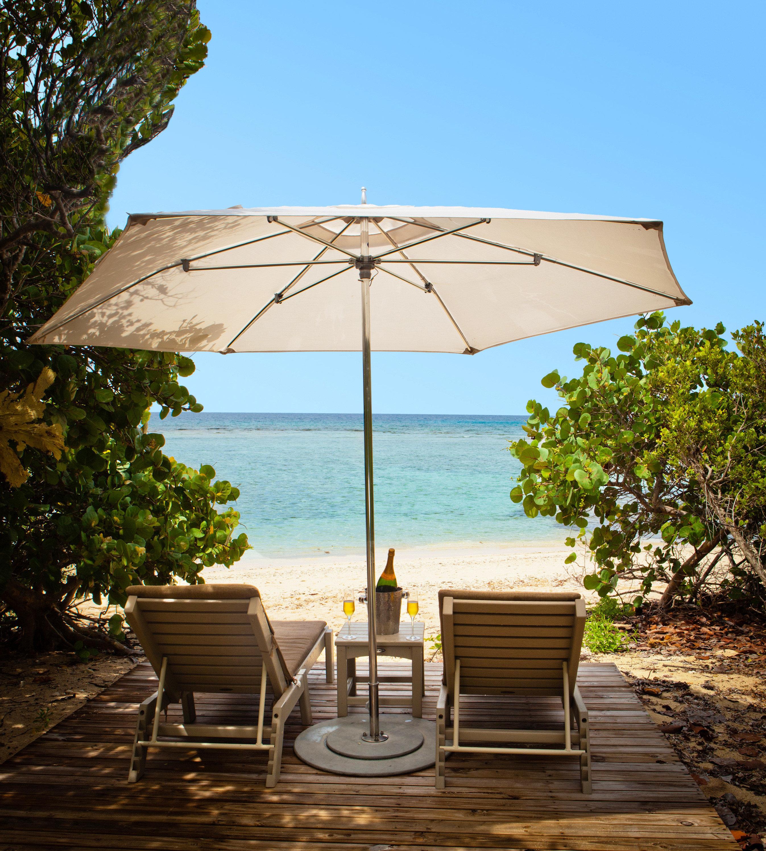 Beach Beachfront Living Lounge Luxury Ocean Secret Getaways Trip Ideas tree outdoor sky umbrella accessory ground Nature outdoor structure estate cottage shore day