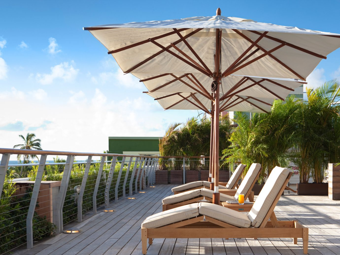 Food + Drink Girls Getaways Hotels Jetsetter Guides Lounge Patio Resort Rooftop Scenic views shopping Style + Design Weekend Getaways sky outdoor tree umbrella chair accessory walkway outdoor structure set furniture shade day