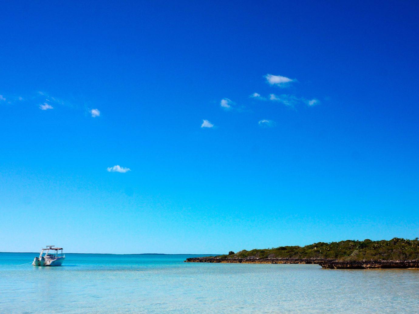 Beach Beachfront Honeymoon Hotels Romance sky water outdoor Boat Sea horizon body of water shore Ocean blue cloud Coast bay Lake dusk Island islet Lagoon distance