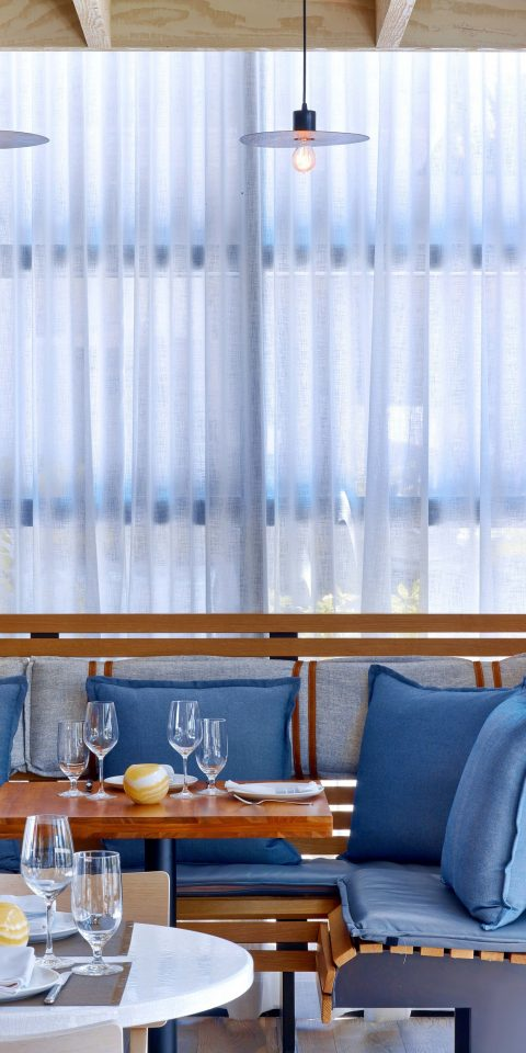 table indoor room interior design window covering curtain window treatment window blind furniture window textile colored