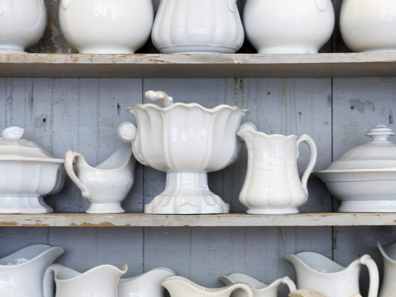 Style + Design row white lined pottery ceramic several art bunch porcelain line counter different shelf group store vase material various dish ceramic ware variety stone