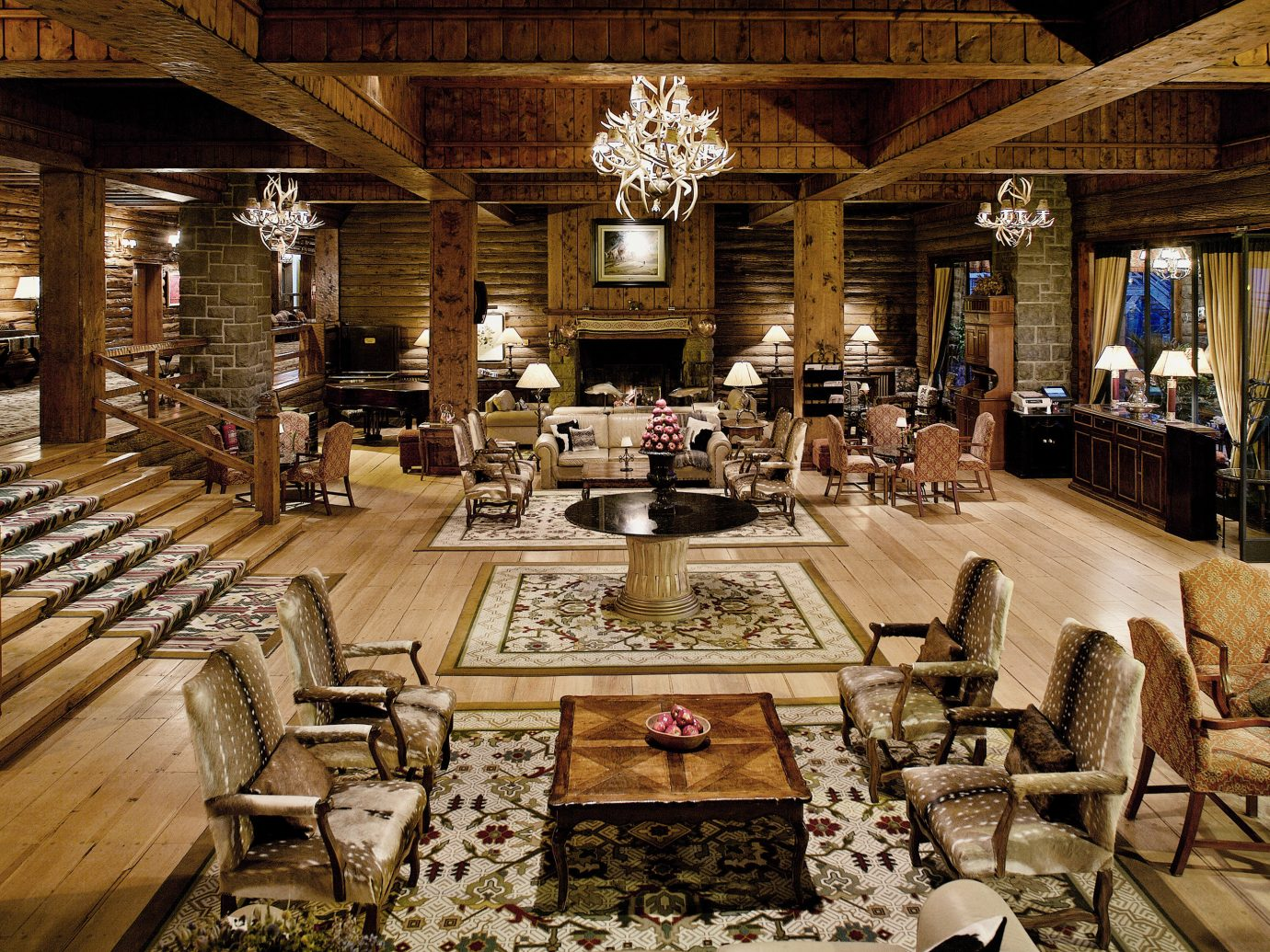 Fireplace Hotels Lobby Lounge Resort Rustic indoor Living estate furniture interior design mansion restaurant ancient history several
