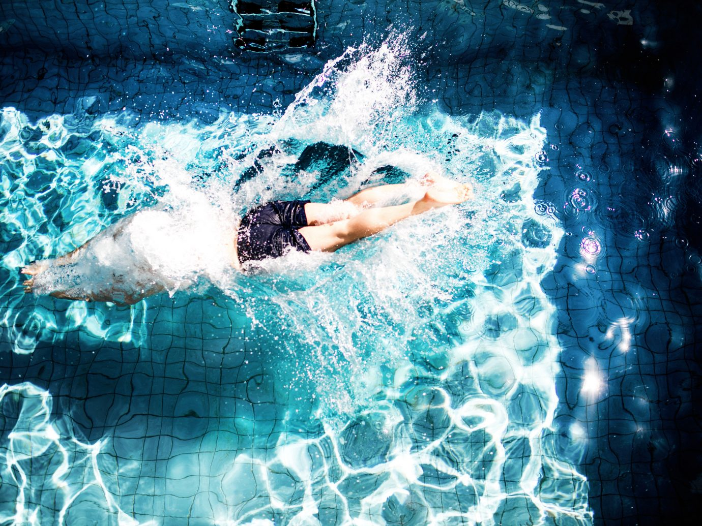 Boutique Hotels Hotels Luxury Travel water blue fun reflection swimming leisure photography underwater swimming pool recreation wave world water sport girl swimmer sky