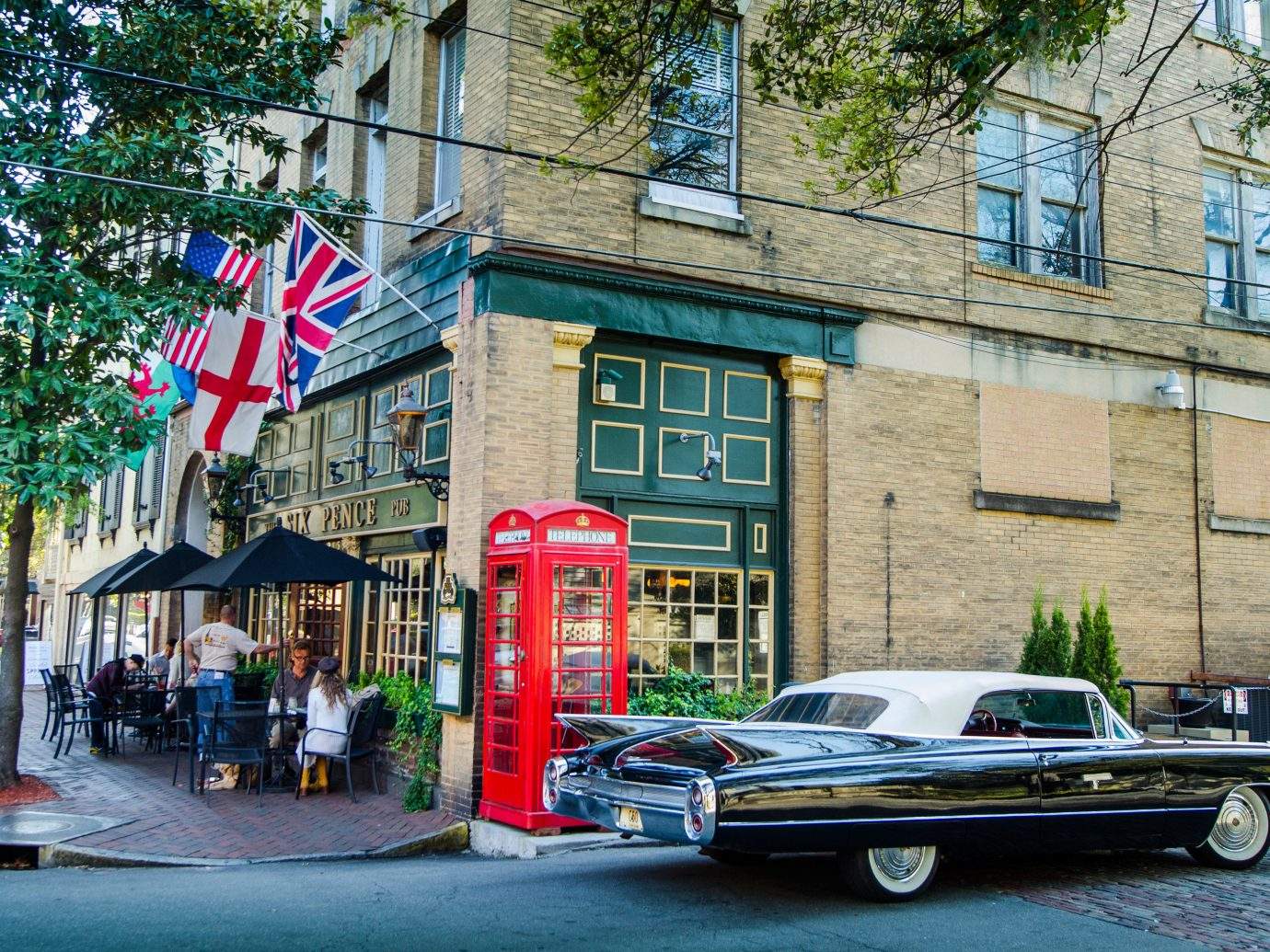 Corner restaurant and vintage car in Savannah, GA