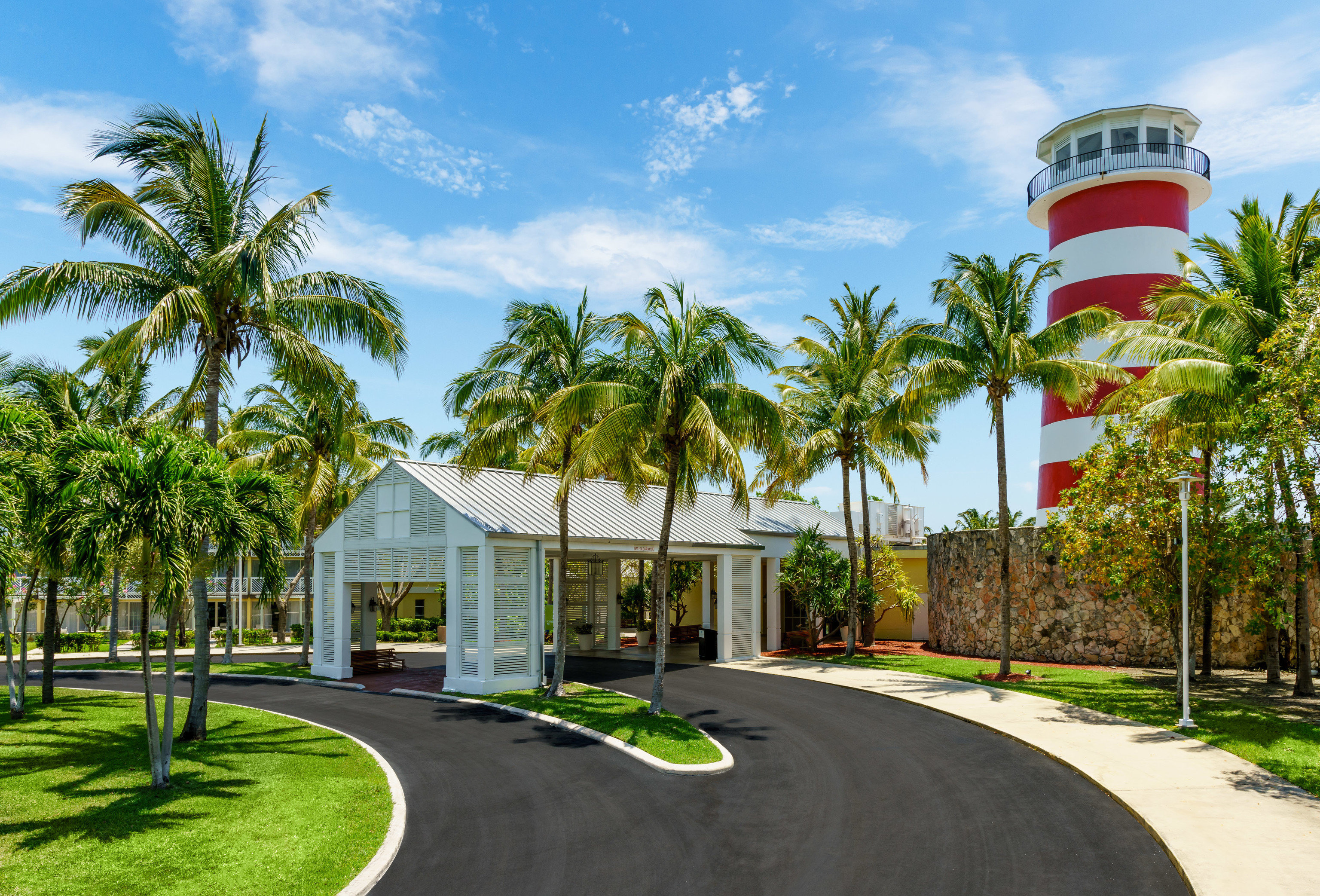 Hotels tree outdoor grass sky palm residential area neighbourhood estate vacation arecales home Resort walkway plant