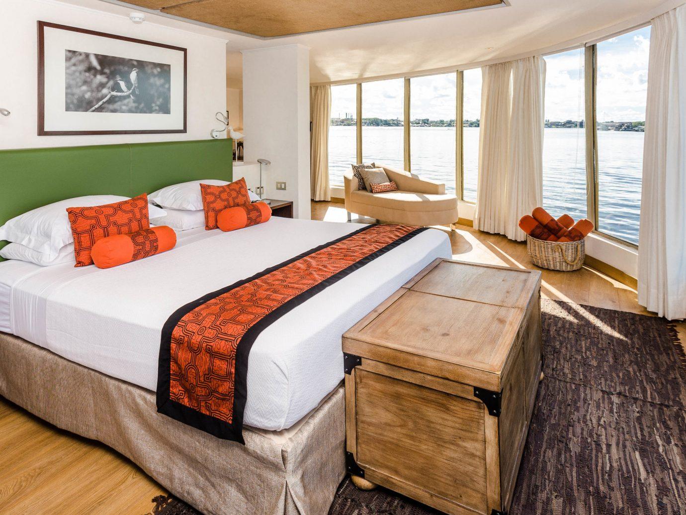 Trip Ideas floor indoor bed room window bed frame Bedroom Suite real estate interior design wood bed sheet flooring furniture