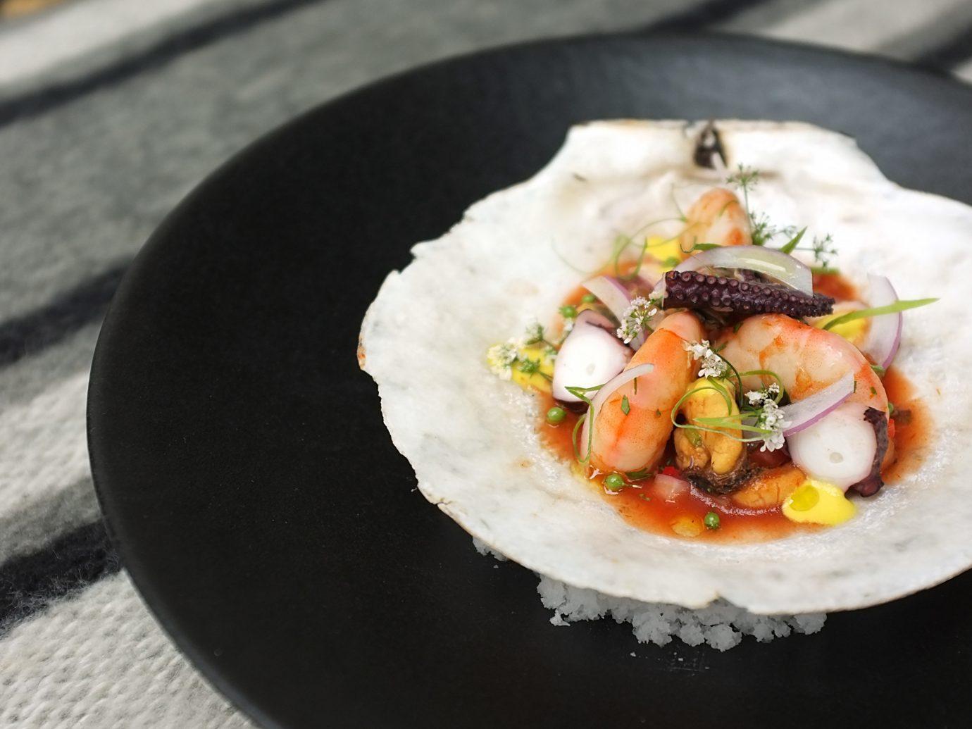 food dish plate indoor black sushi cuisine produce meal sense asian food breakfast Seafood
