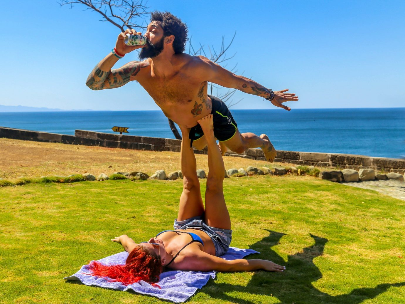 Health + Wellness Meditation Retreats Trip Ideas Yoga Retreats sky outdoor grass water human action person sports physical fitness muscle vacation Sea sun tanning day