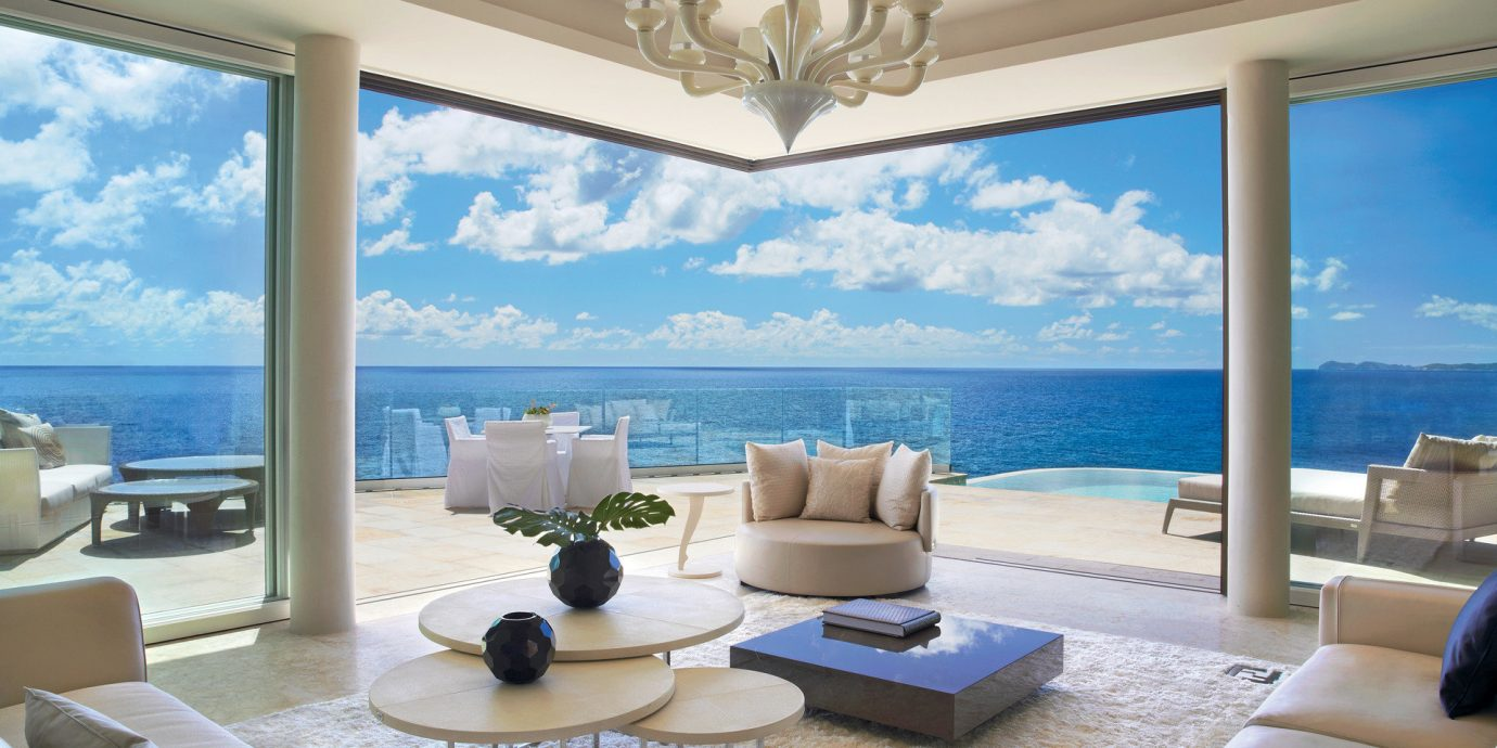 airy calm clean Elegant extravagant fancy Hotels isolation Luxury Ocean ocean view open-air outdoor lounge regal remote sand Scenic views serene sophisticated Trip Ideas Tropical view white sands indoor Living window room property living room condominium furniture estate ceiling swimming pool home vacation Suite interior design Villa screen real estate Resort apartment mansion nice flat overlooking decorated