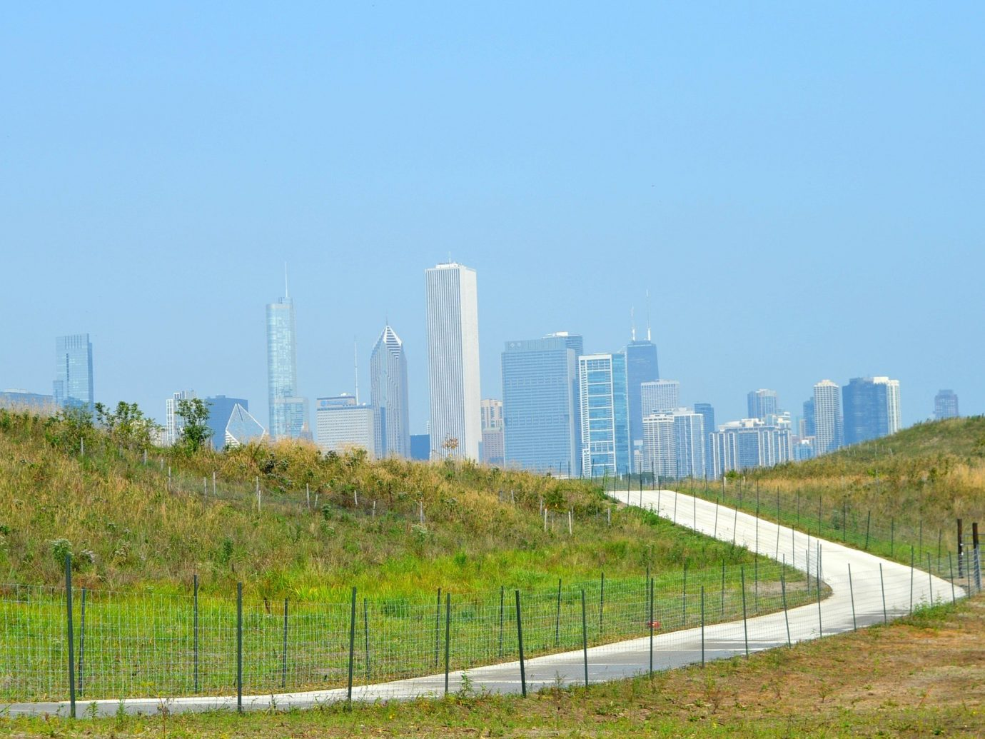 Summer Series grass sky outdoor field transport horizon skyline human settlement outdoor structure Fence tower highway grassy skyscraper pasture lush land