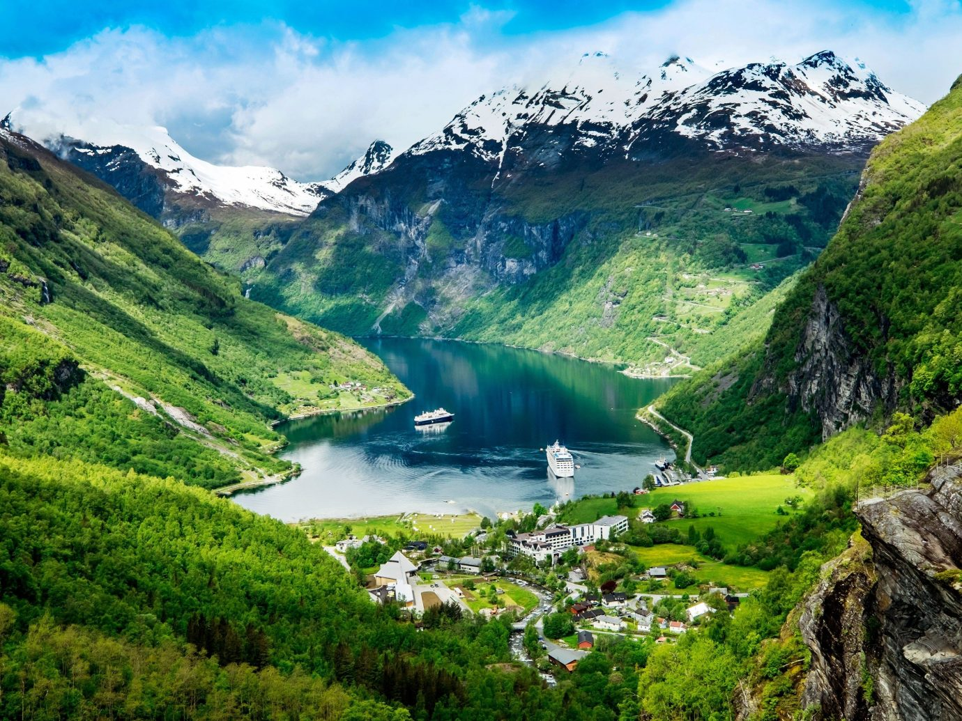 Trip Ideas mountain sky outdoor Nature grass highland mountainous landforms mountain range geographical feature landform hill wilderness fjord hillside Lake tarn loch fell alps valley mountain pass landscape glacial landform green canyon plateau lush meadow national park reservoir grassy overlooking