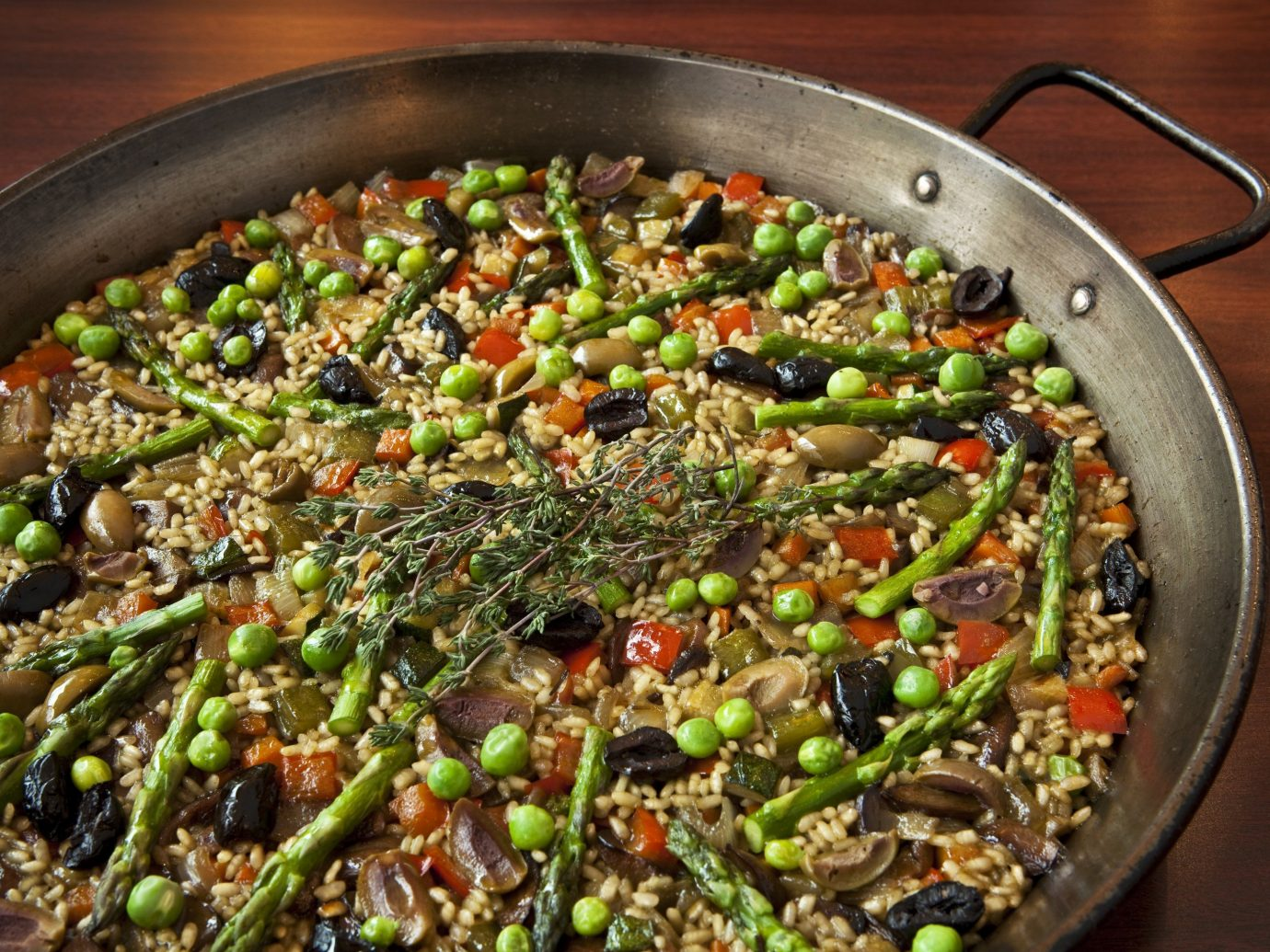 Food + Drink food dish pan produce cuisine vegetable wooden stove paella cooked fresh saute