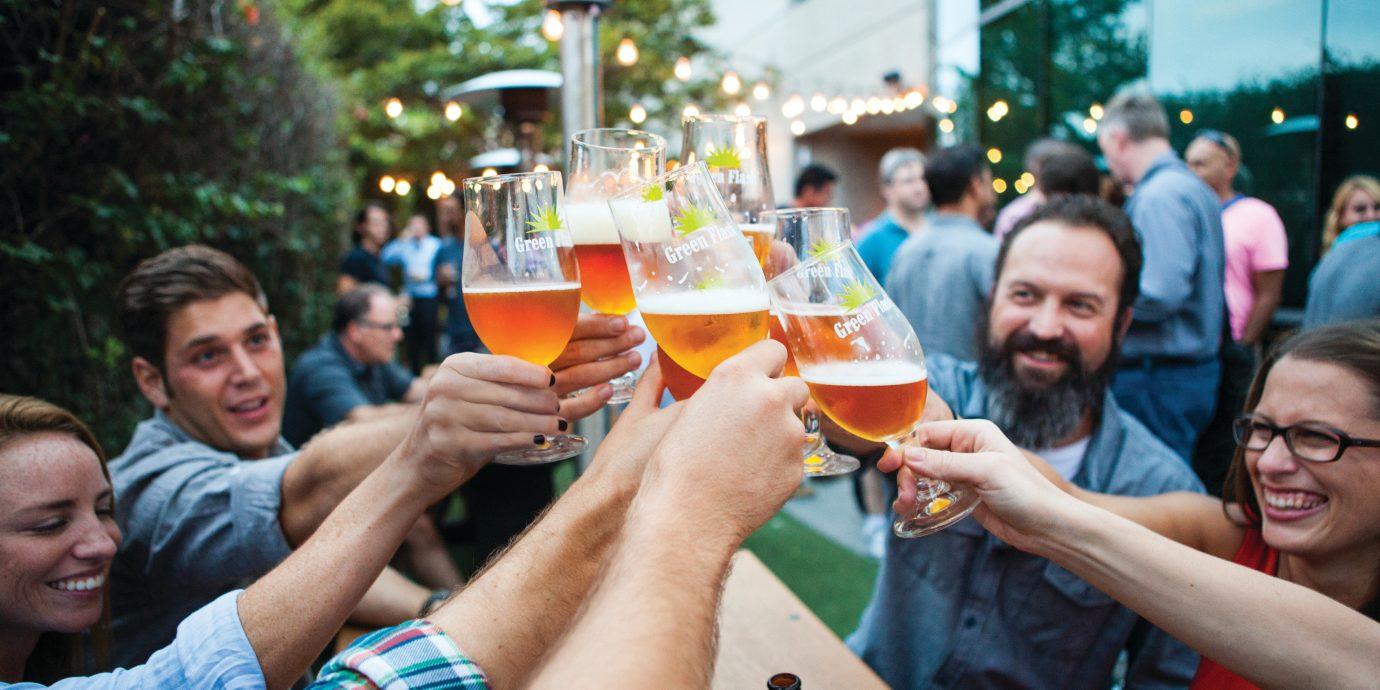Hotels Trip Ideas person outdoor crowd wine people drinking festival Drink