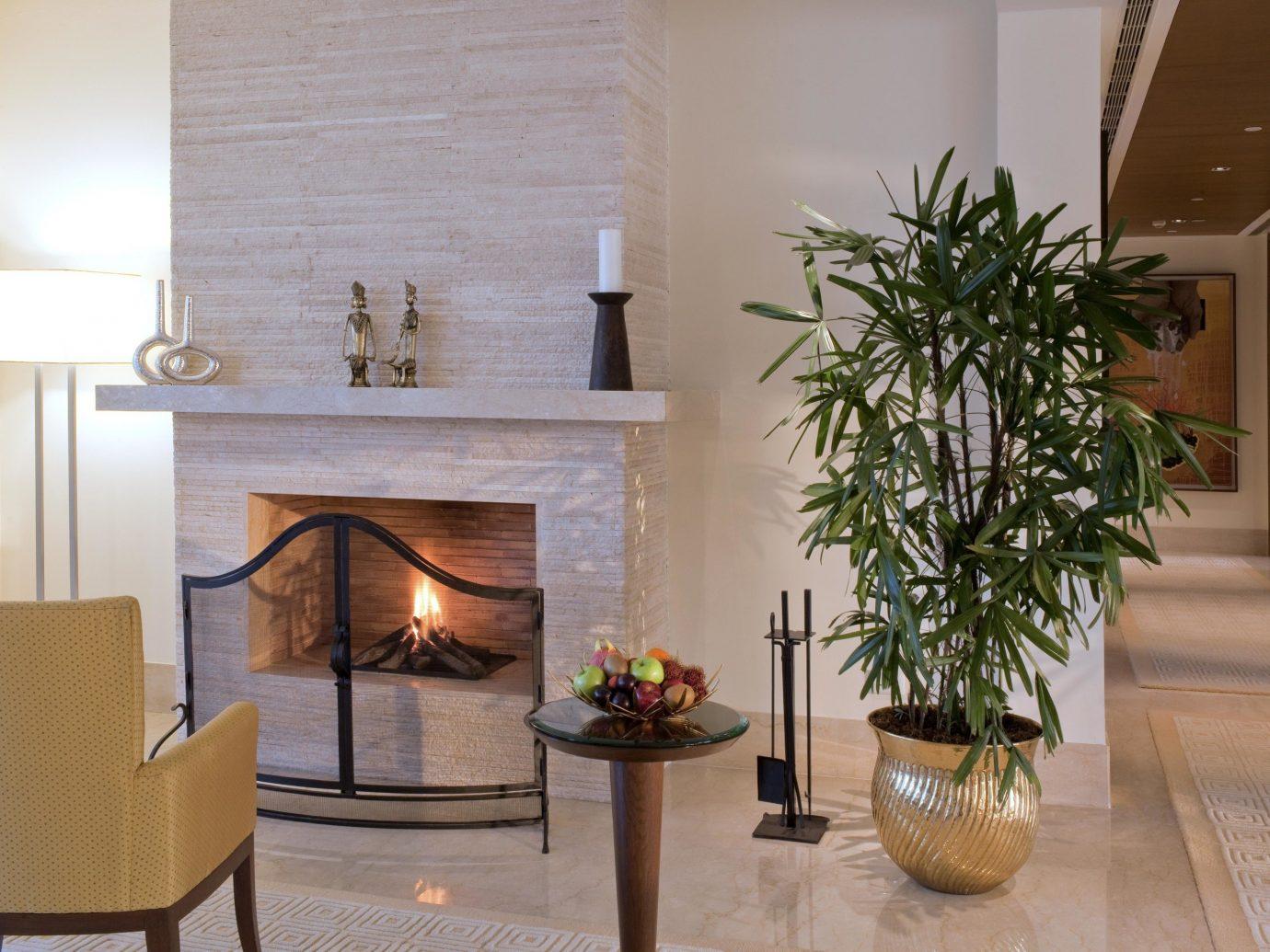 Hotels Luxury Travel indoor living room Living room floor hearth interior design home Fireplace Lobby flooring plant decor furniture table area