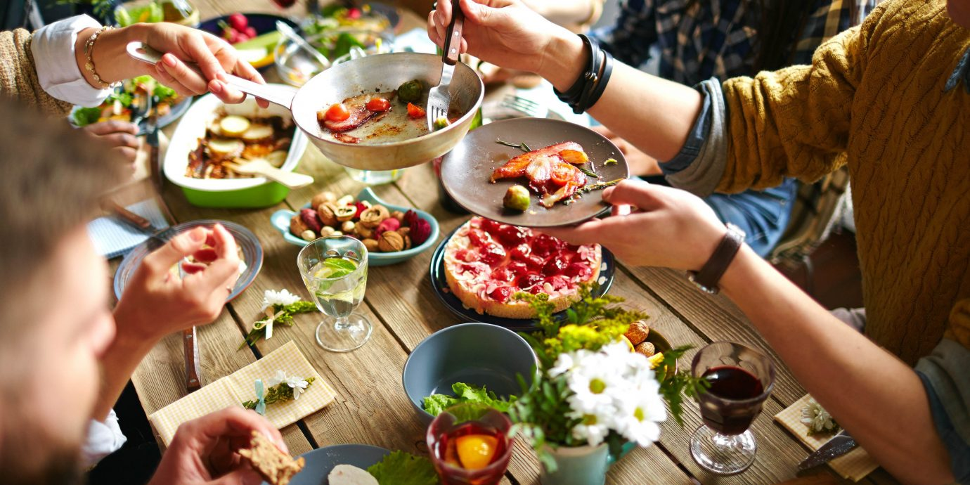 Food + Drink Hotels Trip Ideas person meal food dish brunch cuisine lunch supper eating appetizer breakfast dinner asian food finger food buffet