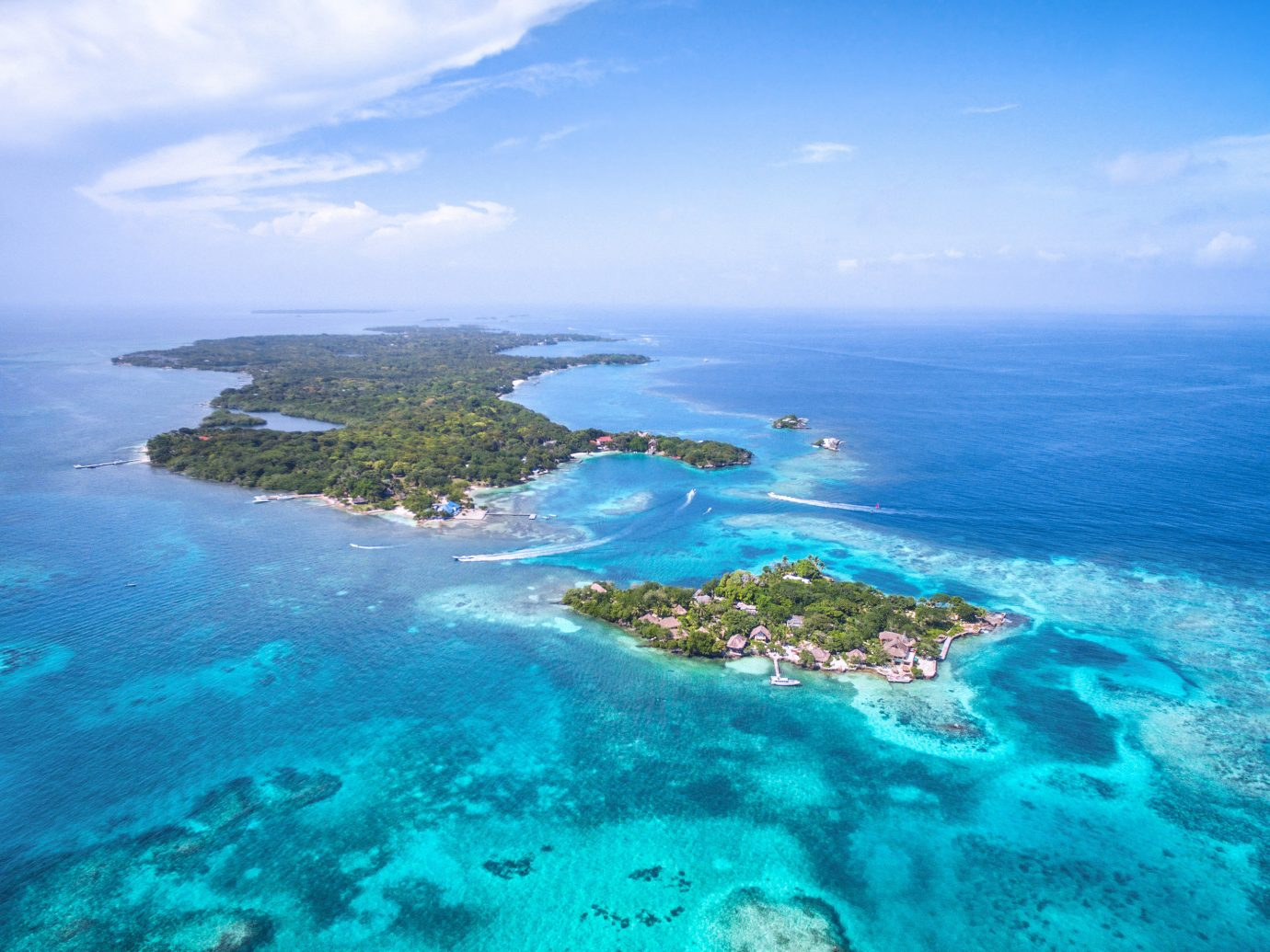 Secret Getaways Trip Ideas coastal and oceanic landforms archipelago Sea islet Island aerial photography promontory reef Ocean water resources atoll cape tropics Lagoon marine biology coral reef Coast peninsula bay bird's eye view water inlet sky caribbean tourism