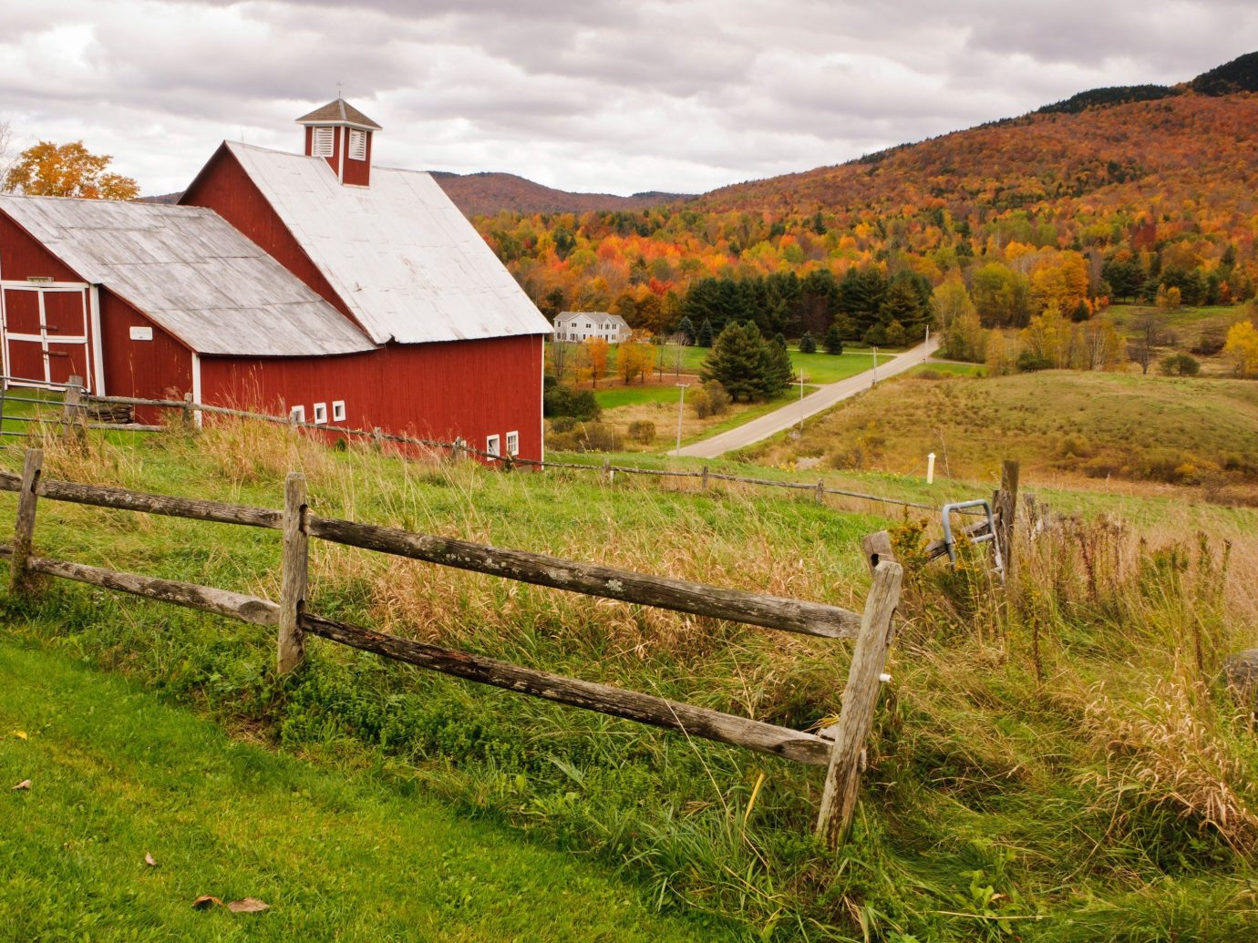 Trip Ideas grass outdoor highland sky building mountainous landforms mountain field pasture house Farm agriculture Fence hill rural area meadow Village grassy valley landscape green mountain range old barn autumn lush hillside