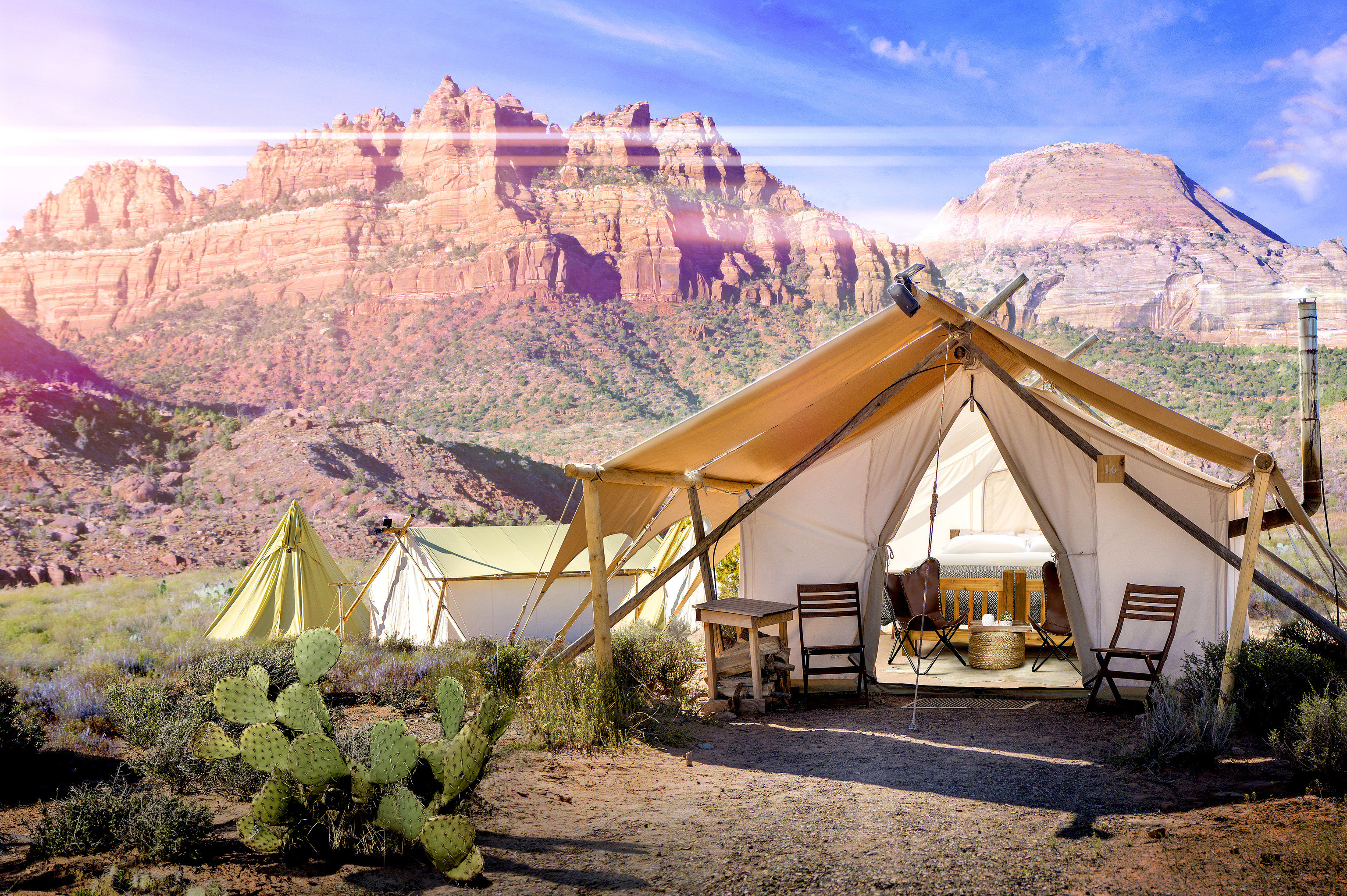 Glamping Hotels Luxury Travel Offbeat Outdoors + Adventure Trip Ideas mountain outdoor sky ground mountainous landforms Town vacation tourism Village mountain range Desert tent landscape valley estate flower dirt