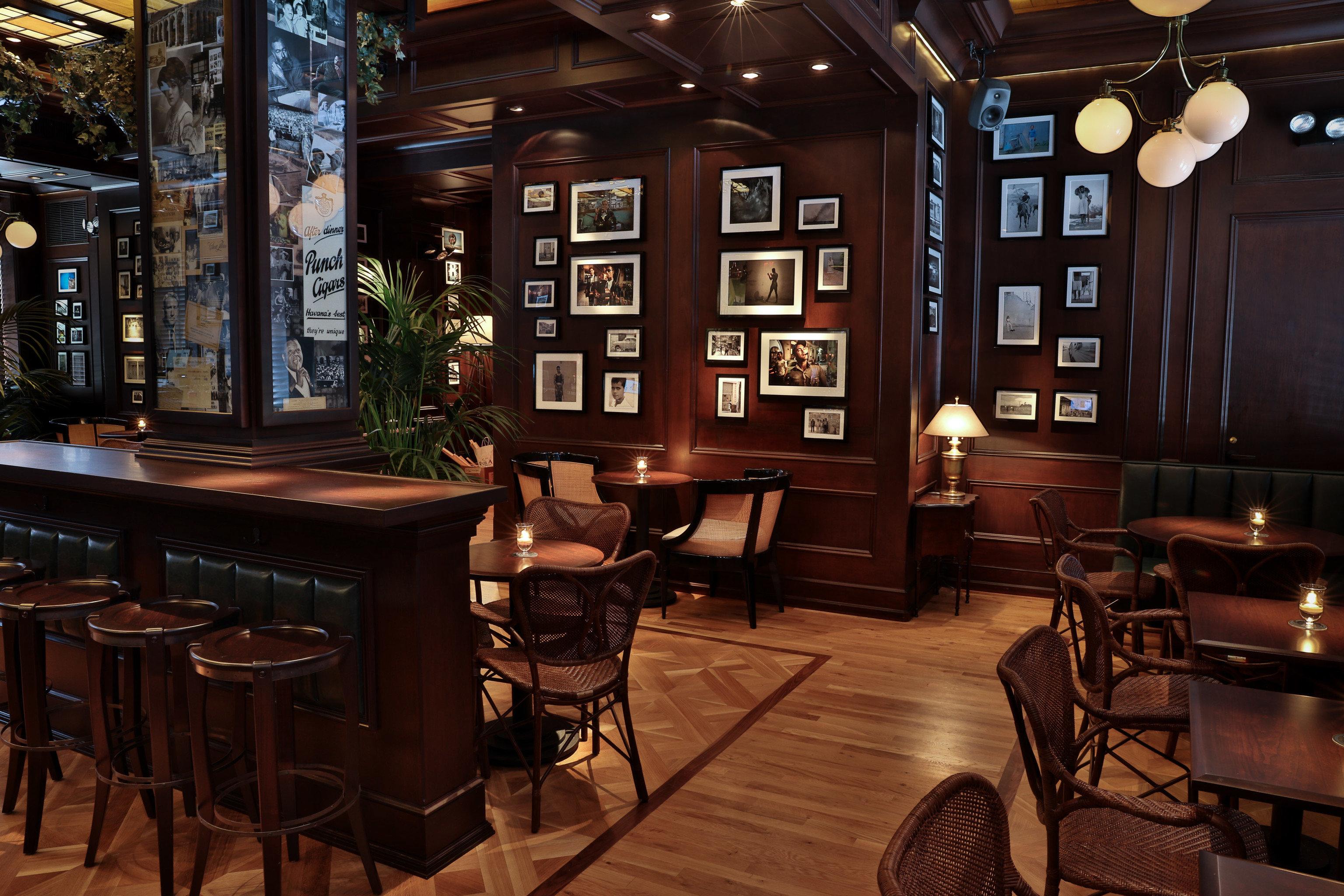 Food + Drink floor indoor chair Bar café restaurant interior design estate recreation room tavern coffeehouse furniture dining table dining room