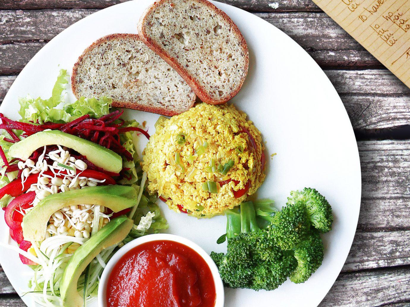 Food + Drink food plate table dish vegetarian food meal cuisine vegetable lunch salad recipe breakfast falafel dip leaf vegetable mediterranean food asian food meat