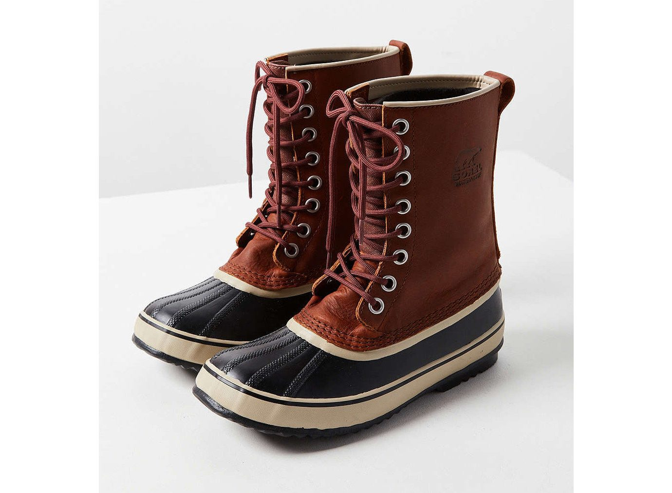 Style + Design Travel Shop footwear clothing boot shoe brown product snow boot feet