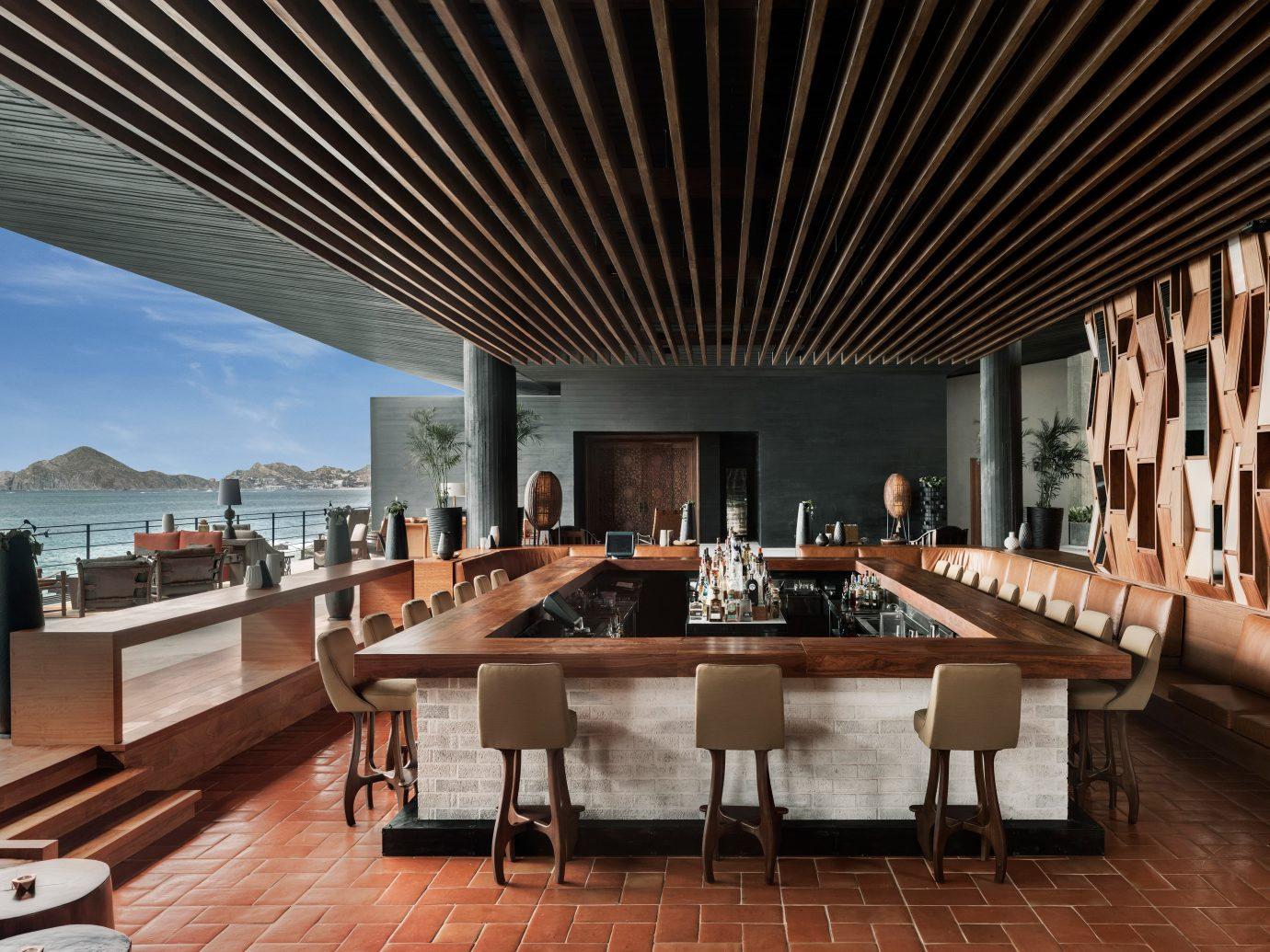 Dining Drink Eat Hip Hotels Modern Nightlife Rooftop Scenic views Trip Ideas Tropical Waterfront floor indoor table chair room Living Architecture Resort estate interior design Lobby convention center furniture function hall restaurant wood