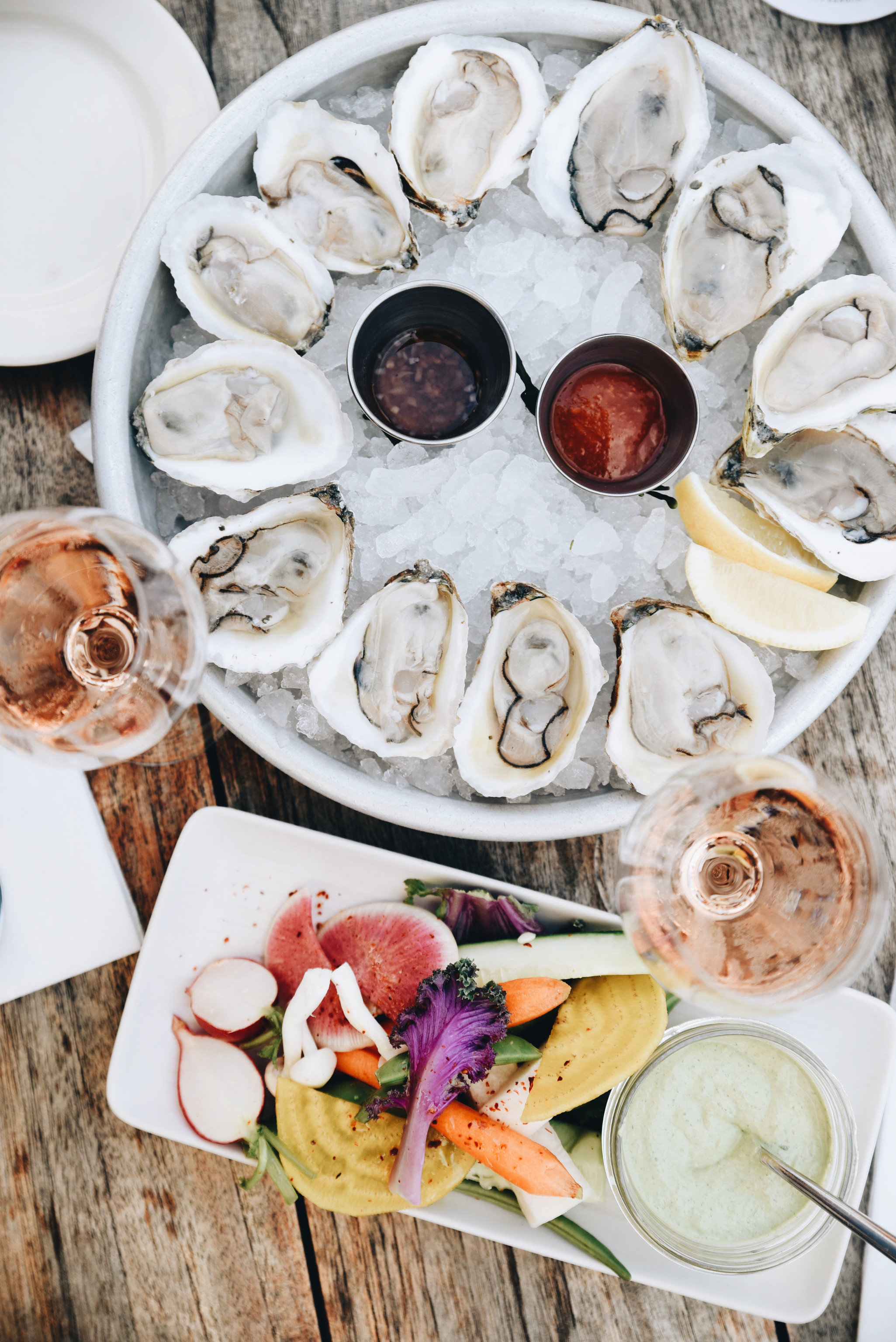 Boutique Hotels Health + Wellness Hotels Trip Ideas food oyster plate Seafood clams oysters mussels and scallops animal source foods brunch dish meal platter clam recipe breakfast different variety