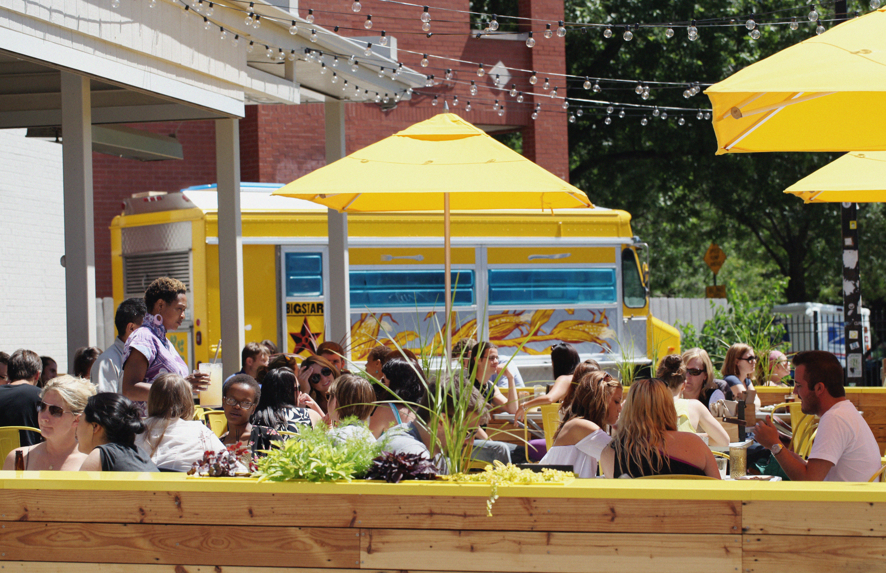 Arts + Culture Food + Drink Hotels Weekend Getaways person outdoor people City vendor group yellow fair lunch several