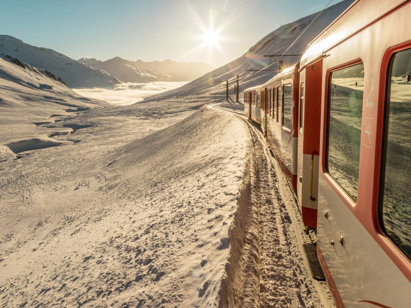 Trip Ideas sky outdoor ground transport mountain Winter snow vehicle traveling train day