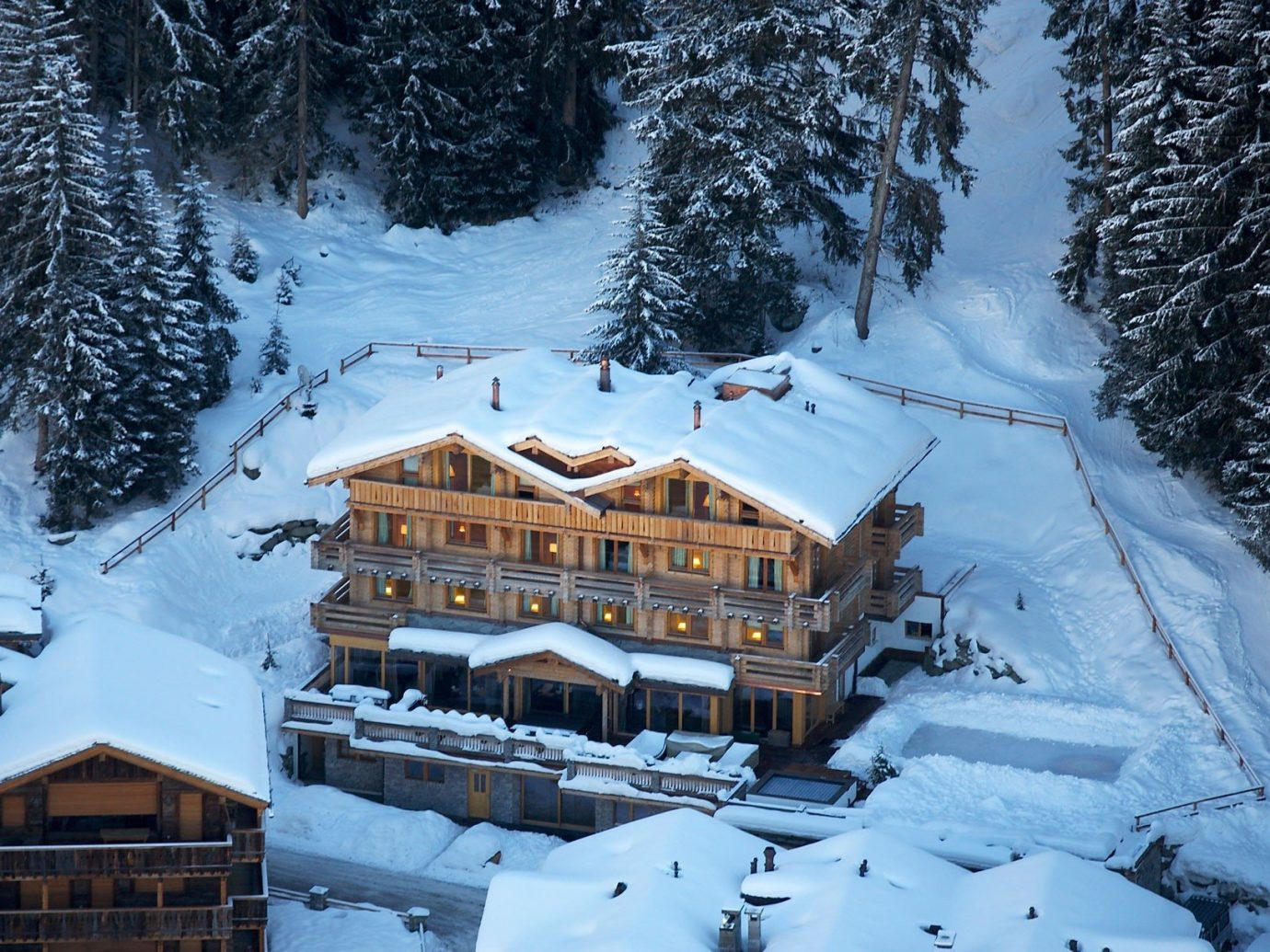 Hotels Luxury Travel Mountains + Skiing Trip Ideas snow outdoor tree skiing Winter weather mountain range geological phenomenon season mountain Resort Nature ski tow piste transport alps winter sport Ski ski equipment nordic skiing Forest surrounded
