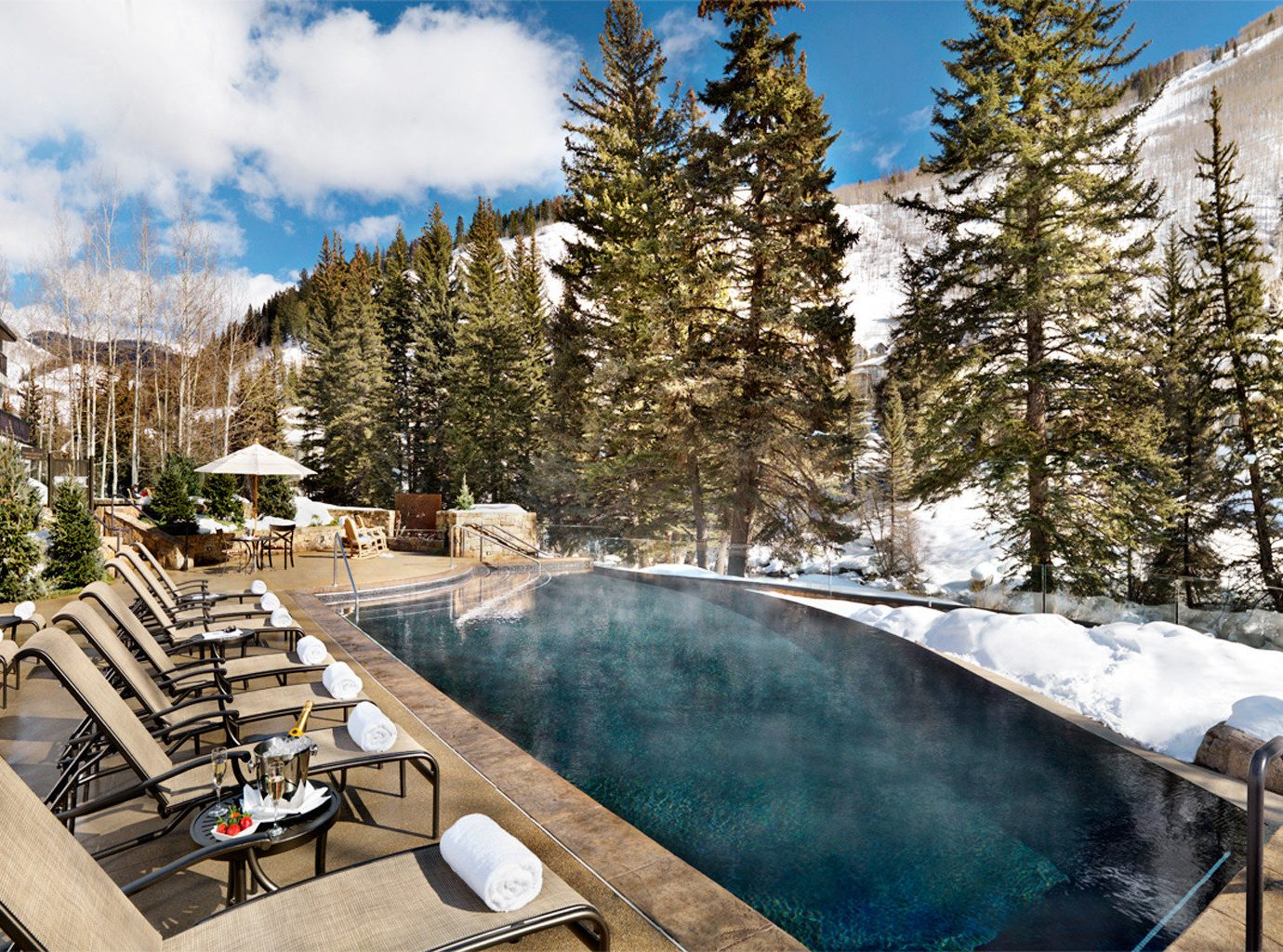 Boutique Hotels Hotels Mountains Nature Outdoor Activities Outdoors Outdoors + Adventure Patio Pool Resort Trip Ideas outdoor sky tree snow Winter season vacation estate swimming pool home backyard